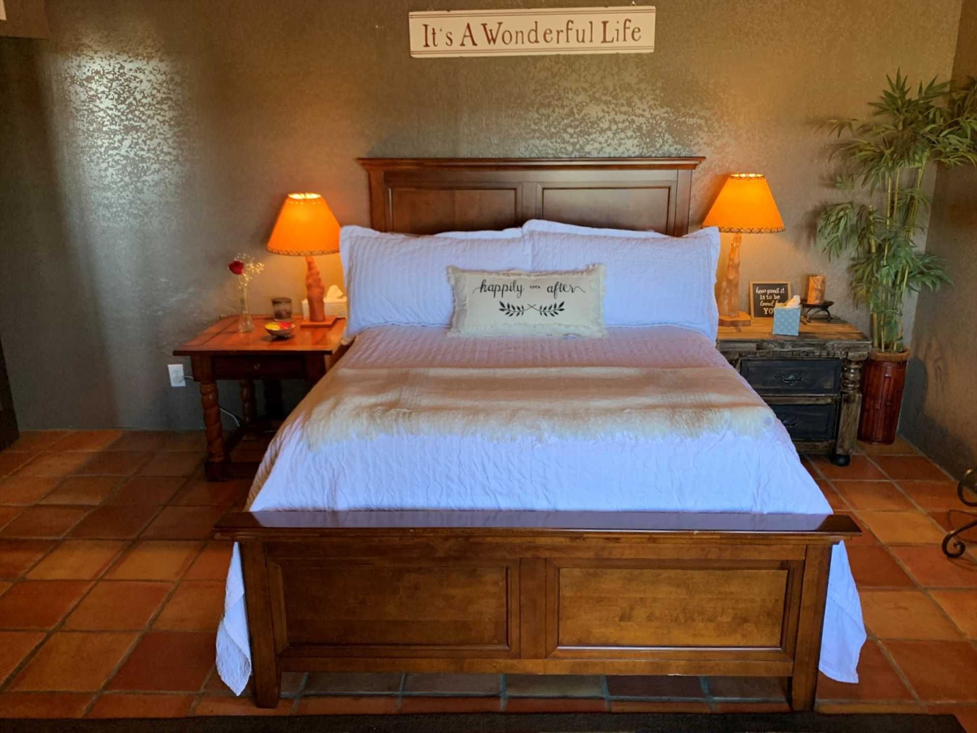 The sign above the plush queen bed reflects a philosophy you'll take home with you after a restful visit here.