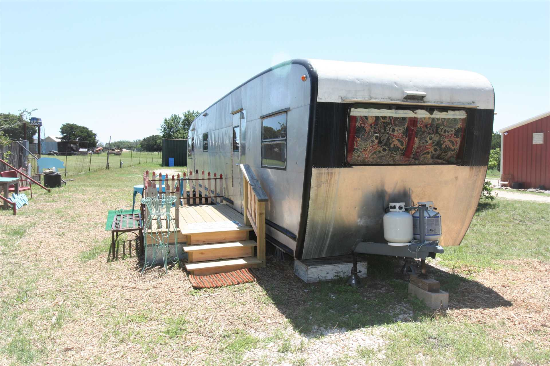 This pretty 50's era Spartanette trailer saw its time on the road, now it's your charming getaway in the Hill Country!
