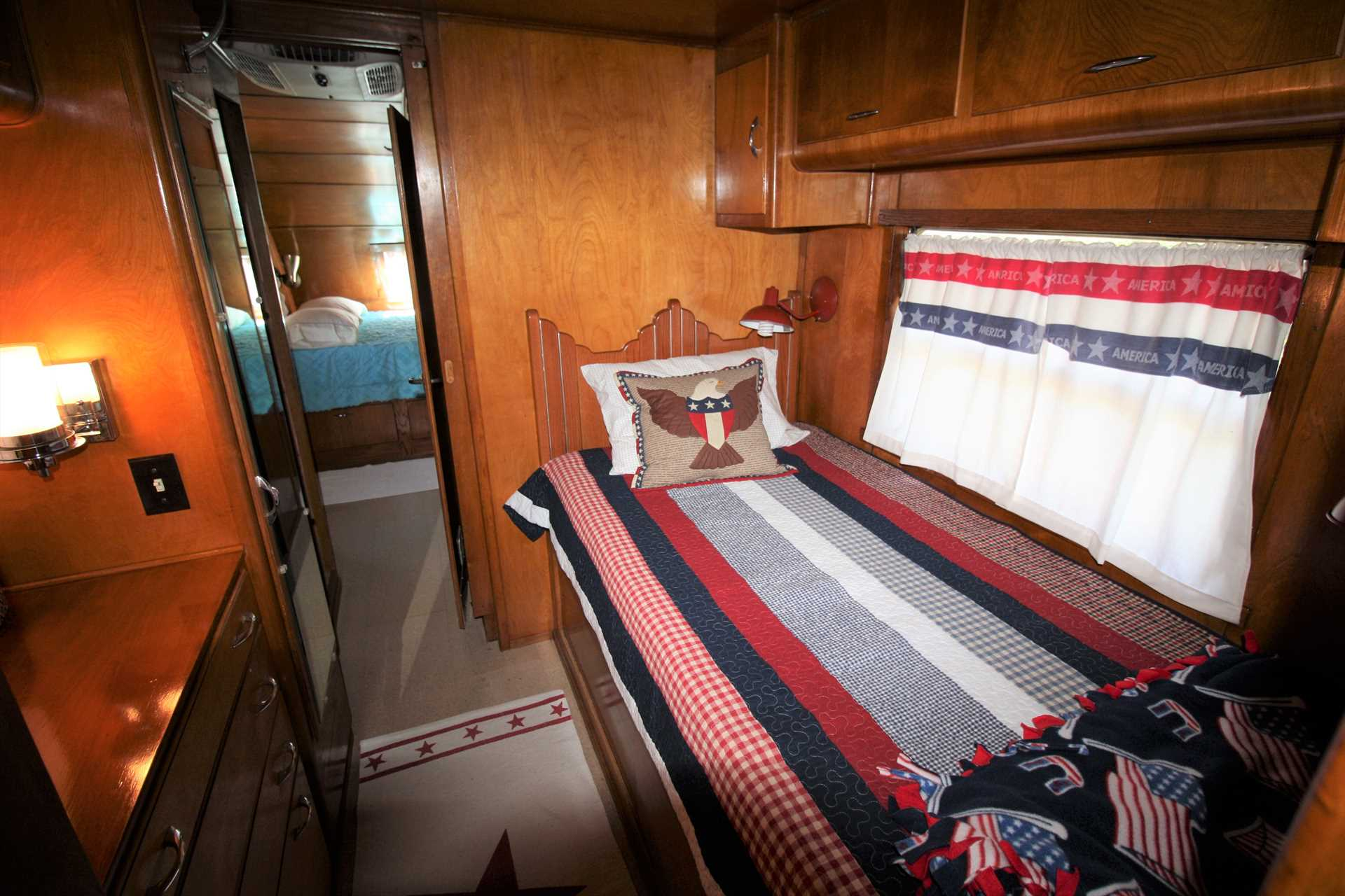 Both beds in the Spartanette are tucked into their own private spaces, and are draped in clean, soft, and warm linens.