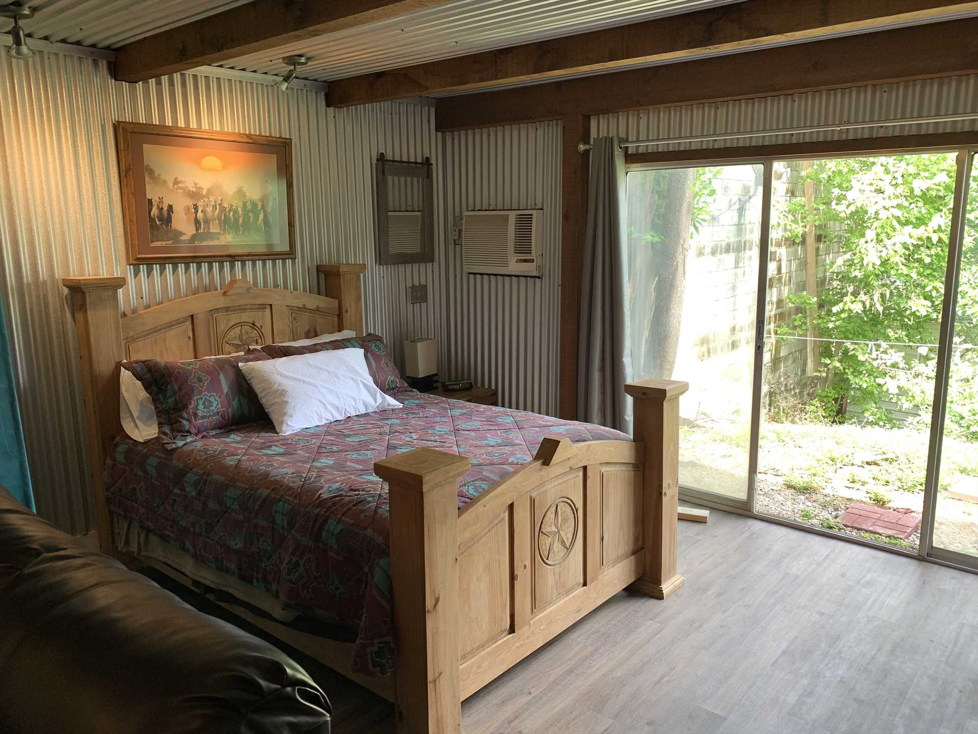Dream of further Hill Country adventures on the comfy queen-sized bed! Clean linens are provided, and two more guests can rest on the full futon in the living area.