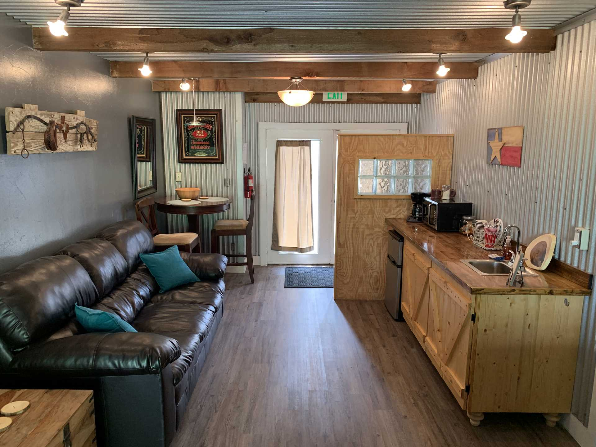 Here's the cozy living area and kitchenette. Your entire interior space is kept comfortable with efficient AC and heating units!