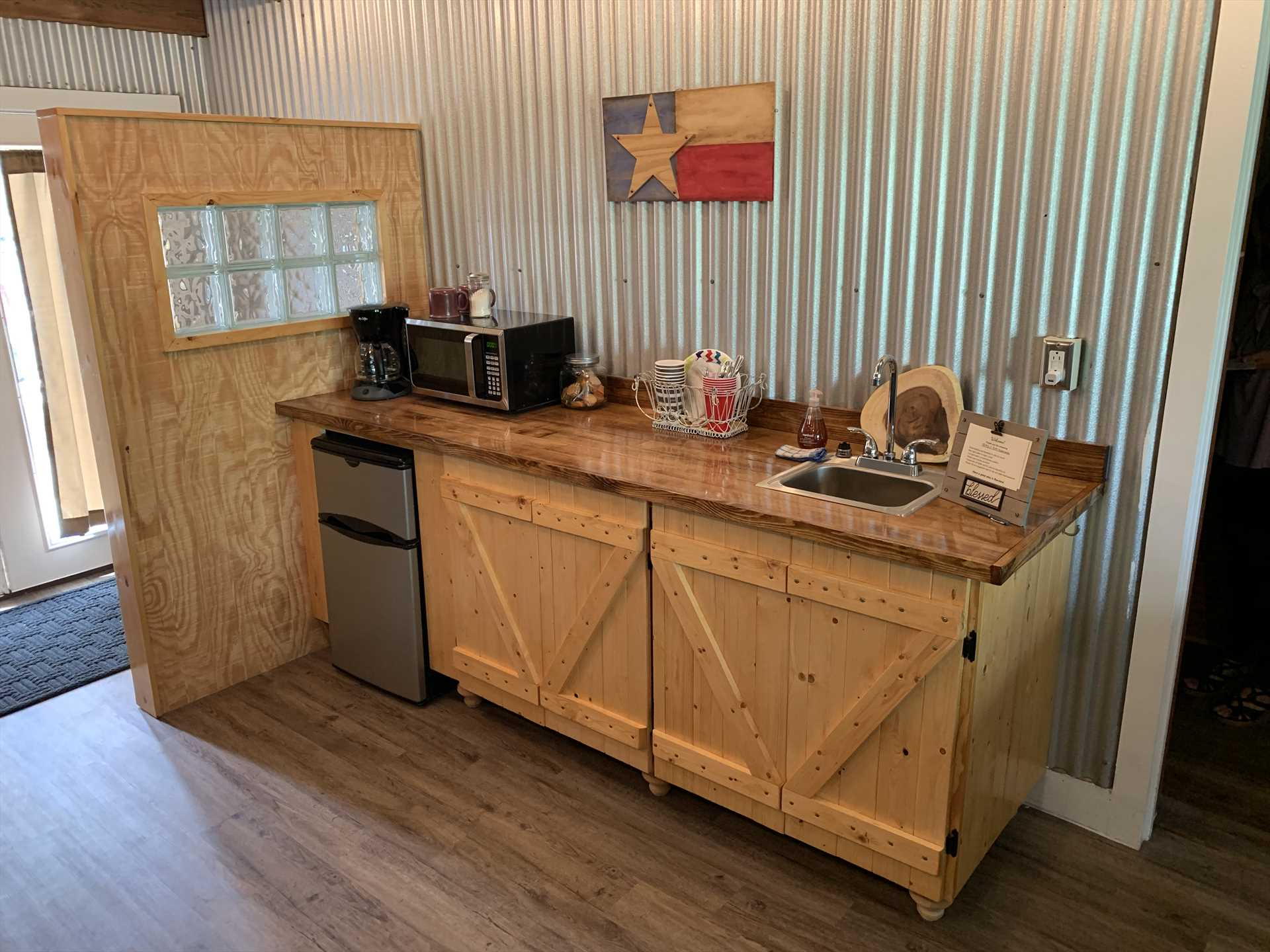 The tidy kitchenette also comes with complimentary coffee and disposable plates, utensils, and glasses.