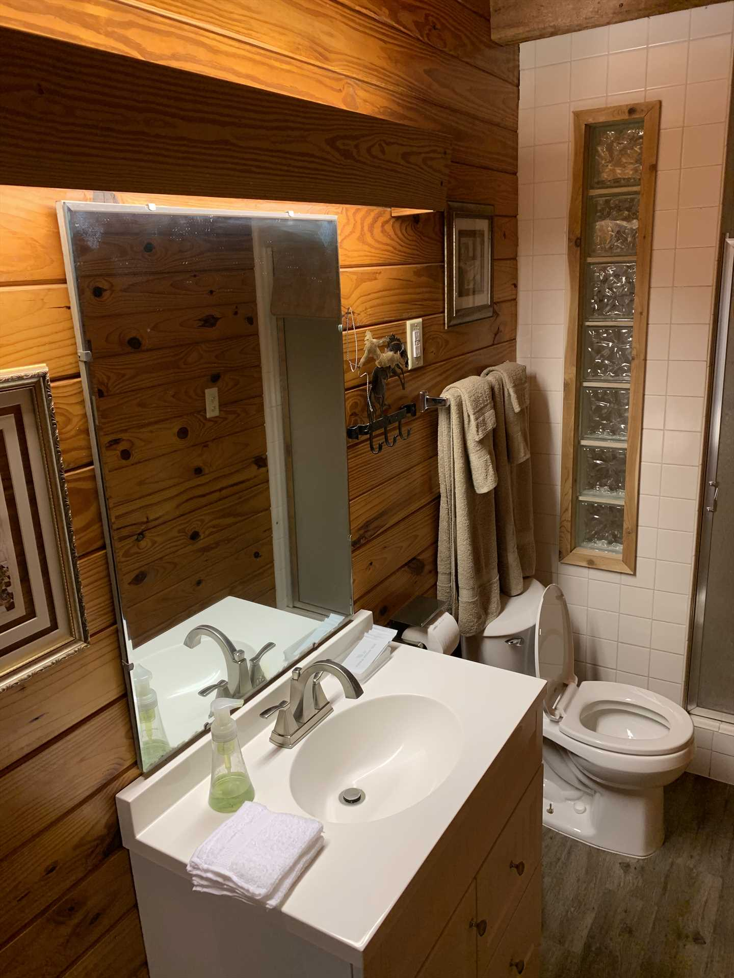 Rustic woodwork and clean and modern amenities make even the bathroom a memorable space! All bath linens are included with your rental, too.