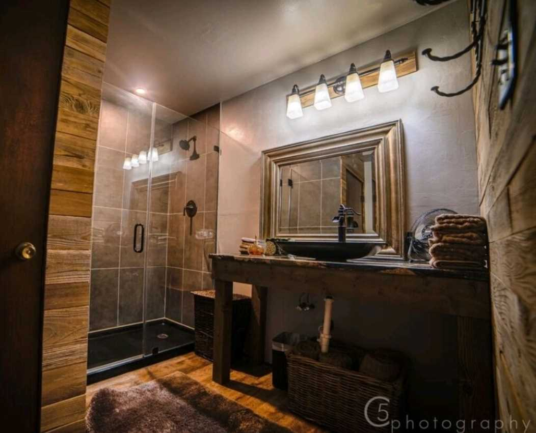 Clean design lines and functional fixtures like a walk-in shower, toilet and vanity make the second bath the perfect clean-up spot.