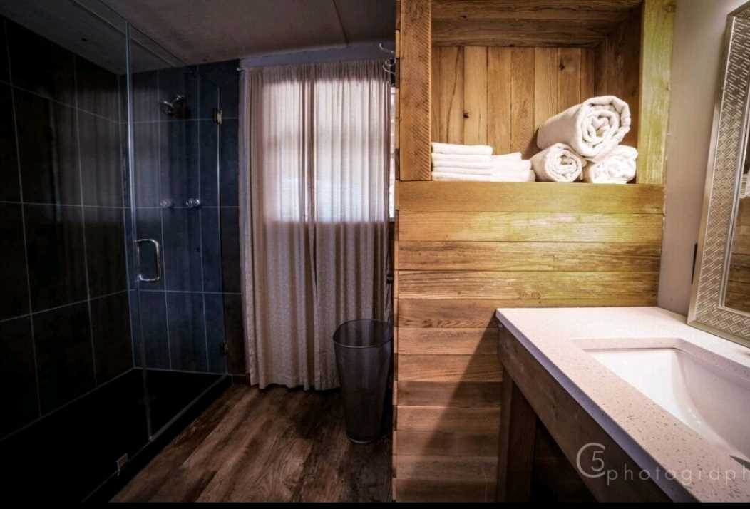 Check out the big shower stall and vanity in the master bath! All bath and bed linens for your stay are provided, too.