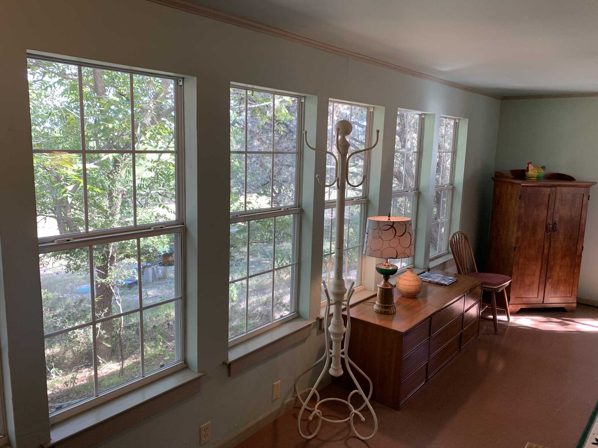 Plenty of windows and mellow woodwork create a soothing and welcoming ambience.