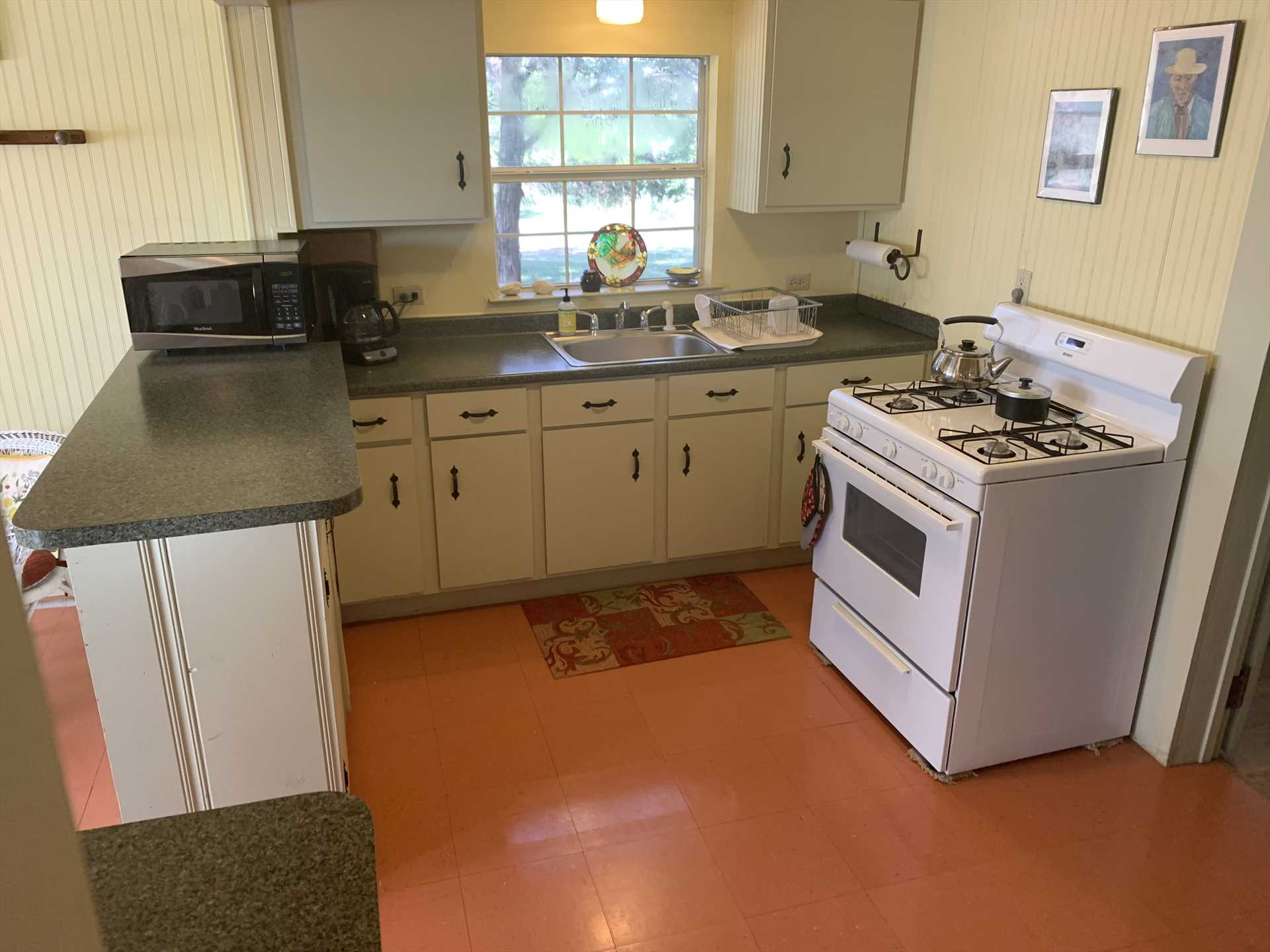 The fully-equipped kitchen also includes complimentary snacks!