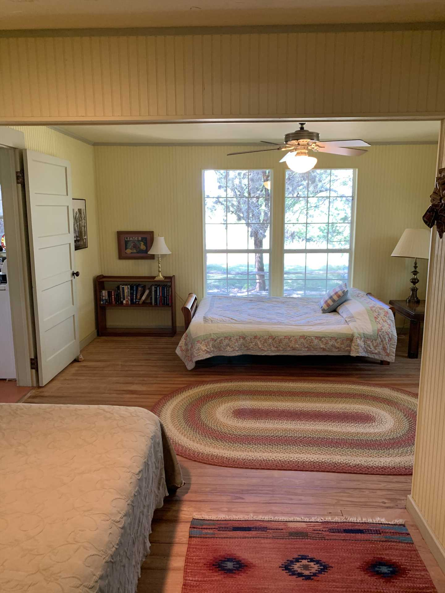Restful slumber will greet you in the main bedroom, furnished with both a queen and full bed.
