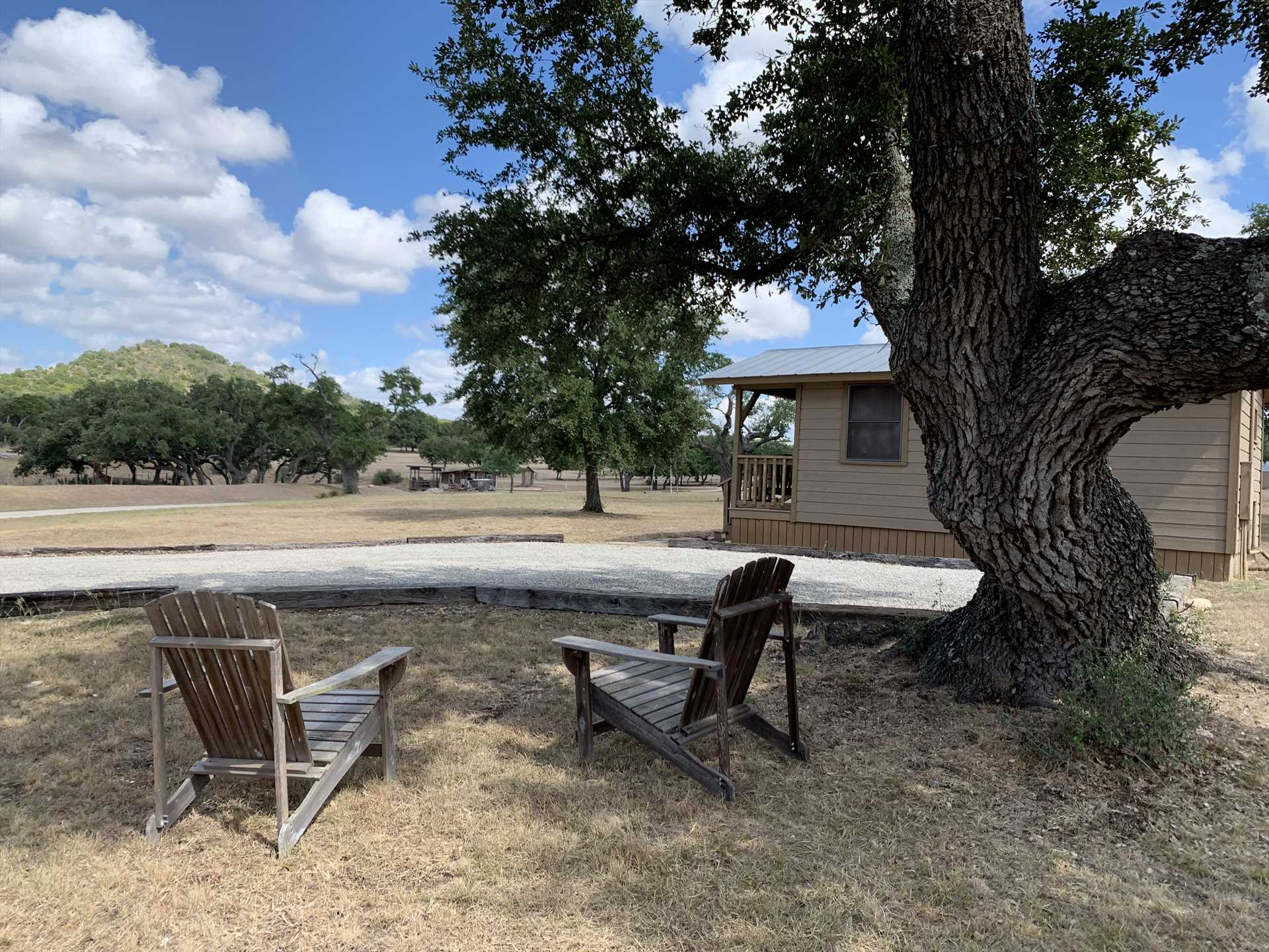 Have yourself a relaxing sit-down under the shady oak in the comfy Adirondack chairs, and savor the Hill Country views and fresh air!