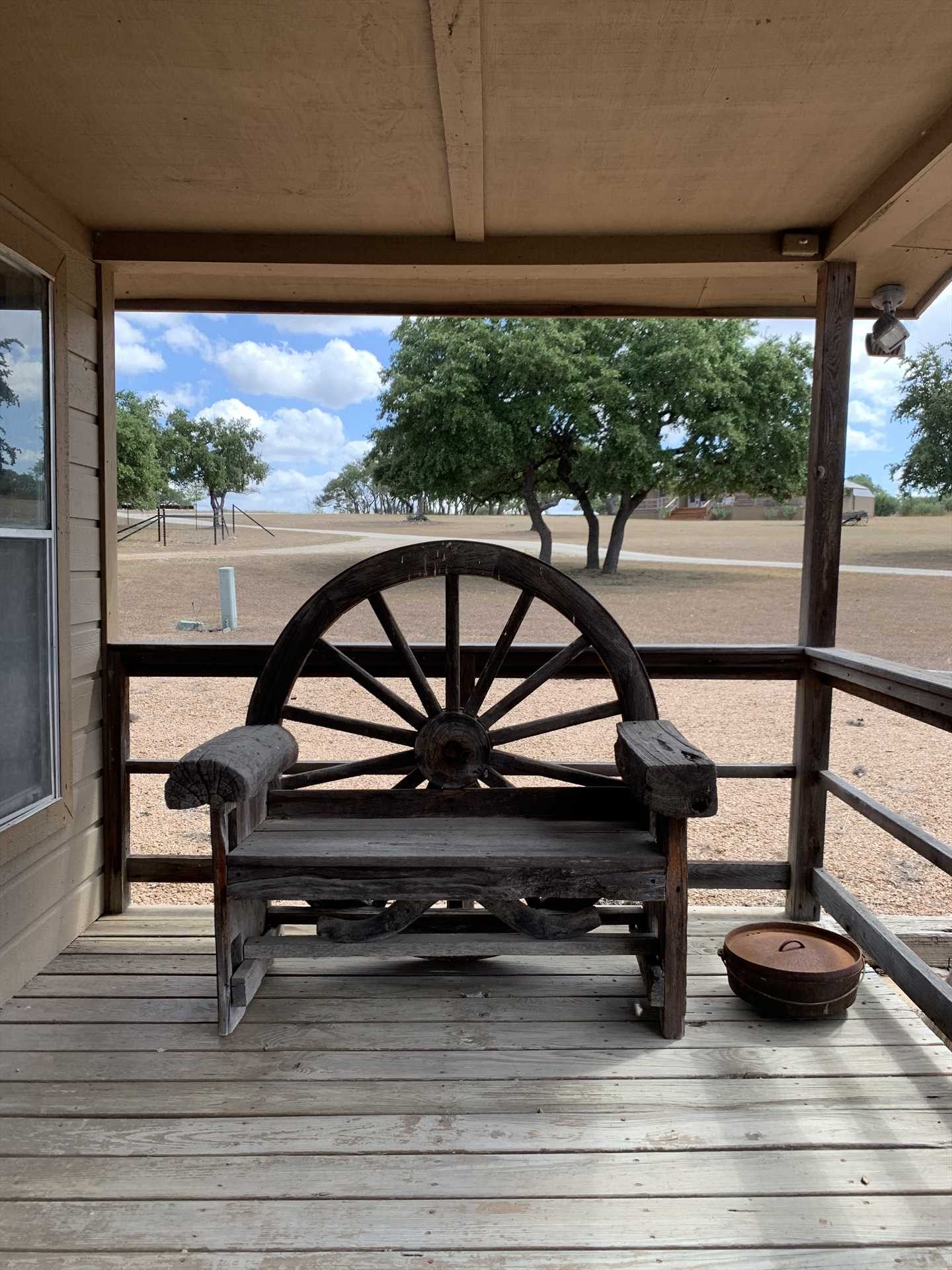 Relaxing shaded spots and touches like the wagon wheel decor at the pavilion make Tabasco Ranch a truly Texan experience.