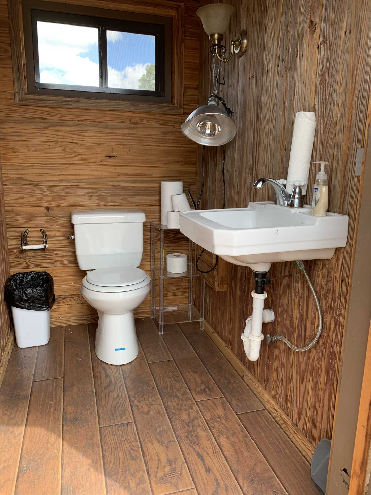 A shared outhouse (with modern updates, of course) is on the grounds for guests who don't necessarily want to return to their cabins.