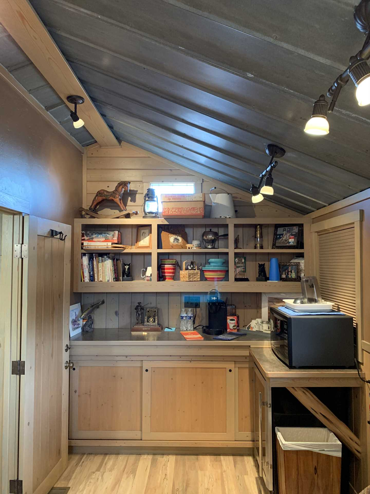 Coffee basics, a microwave, and mini fridge round out the cozy kitchenette. For more cooking space, check out the shared pavilion!