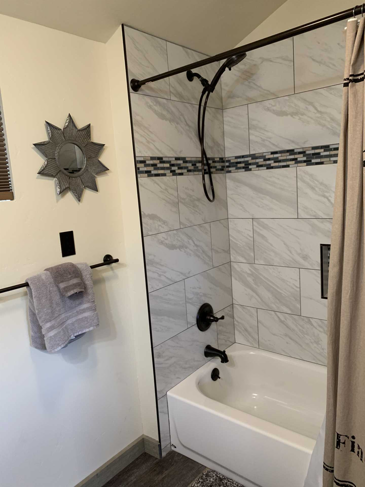 Clean up in style and comfort in the shower and tub combo in the cabin's full bath!