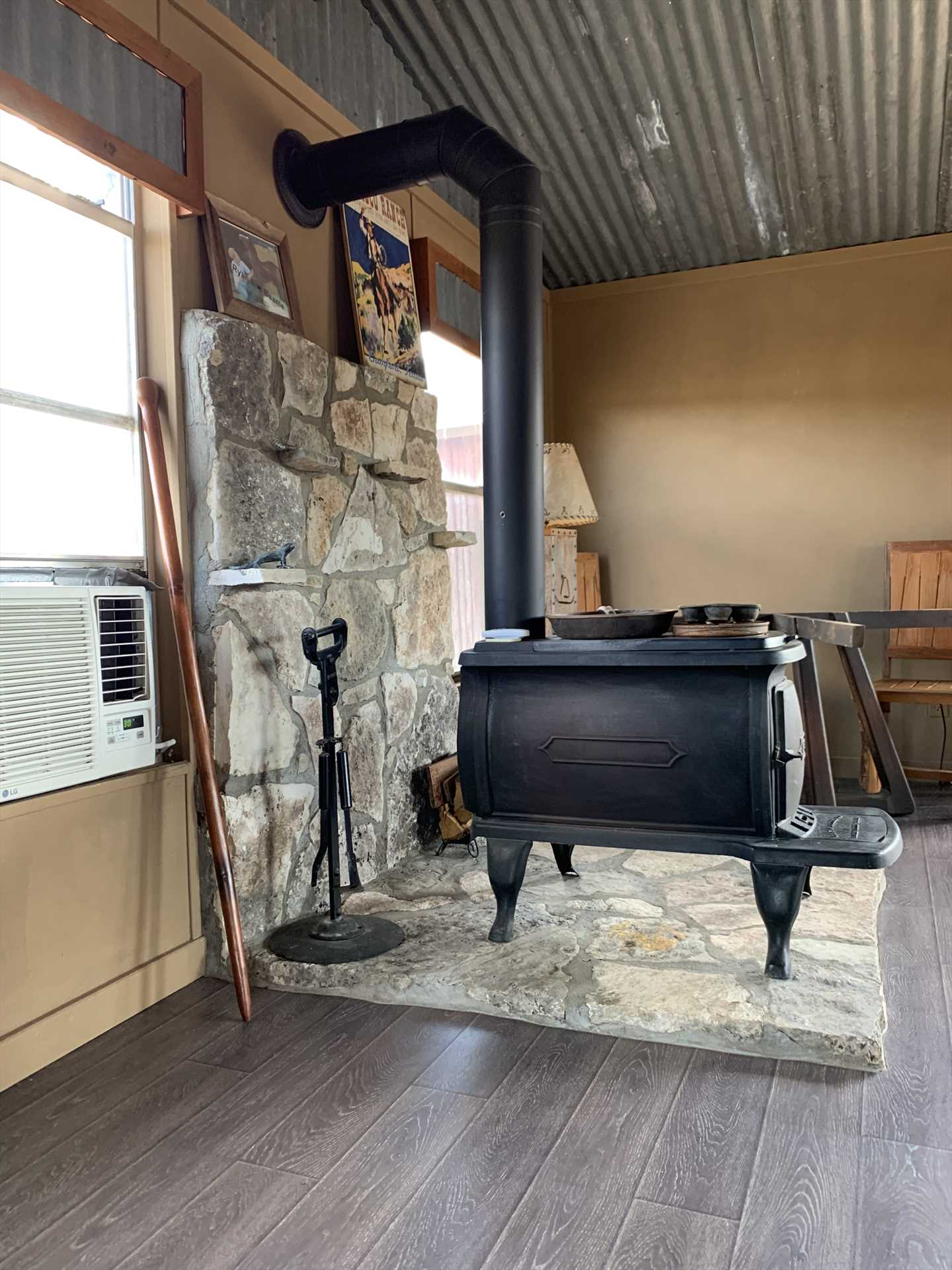 The interior of the pavilion has box AC for those hot Texas days, and there's also a functioning vintage wood-burning stove.