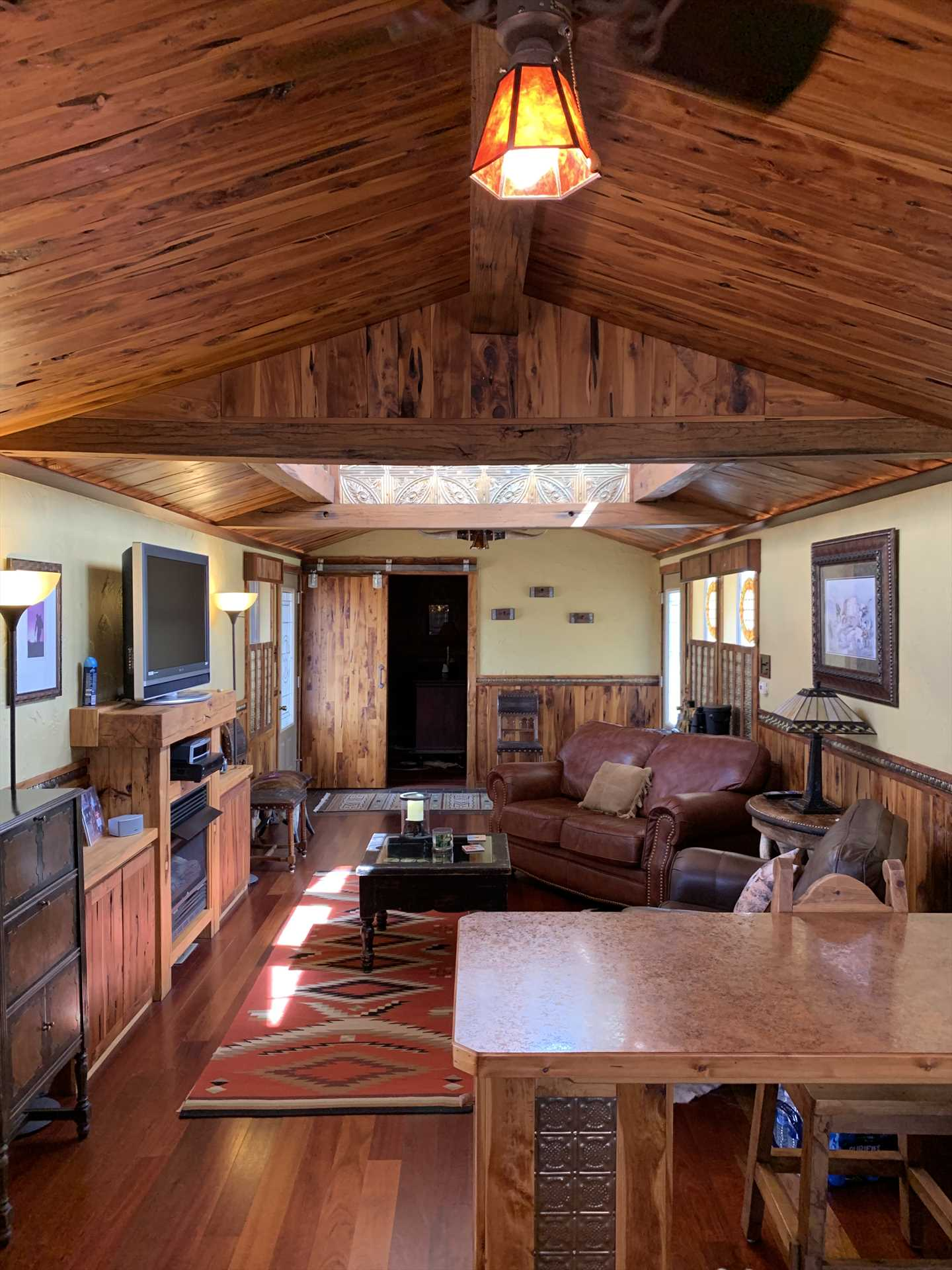 Vivid southwestern flair shines through in every detail and furnishing in the colorful and comfortable Antler Cabin.