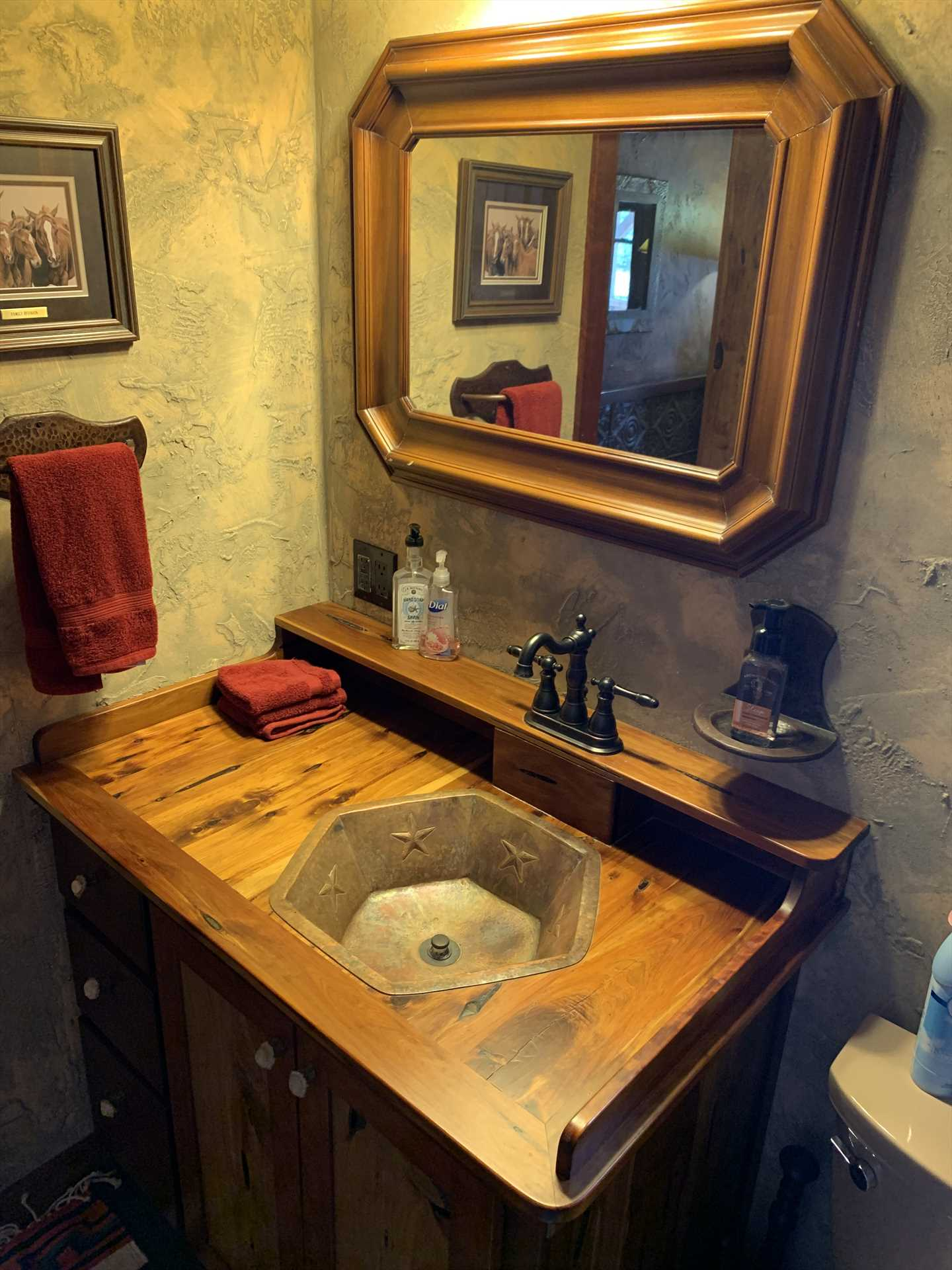 Unique woodwork and geometric furnishings make even the bathroom at the Antler Cabin stand out!