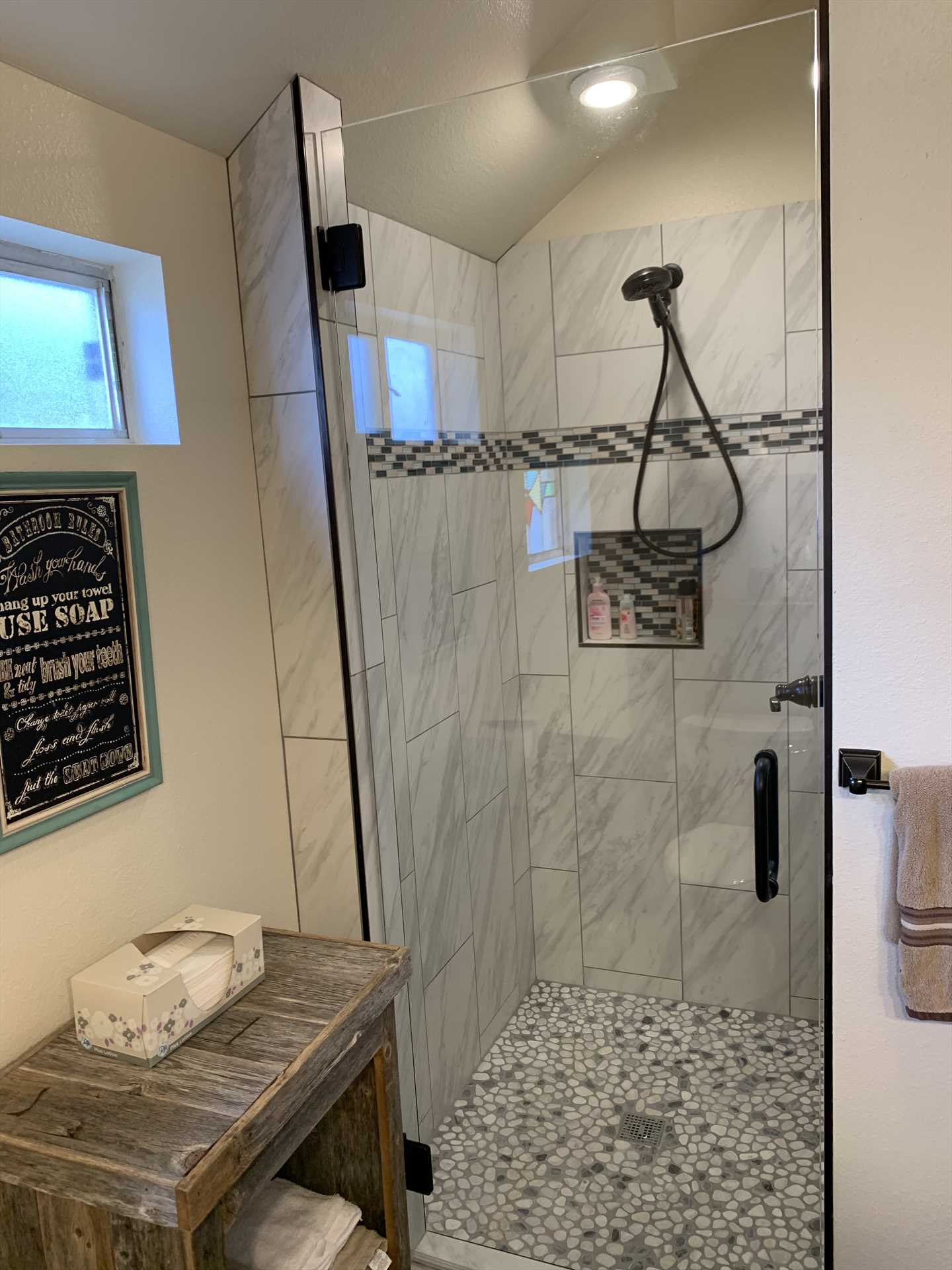 A stylish, tiled shower stall makes cleanup a pleasure!