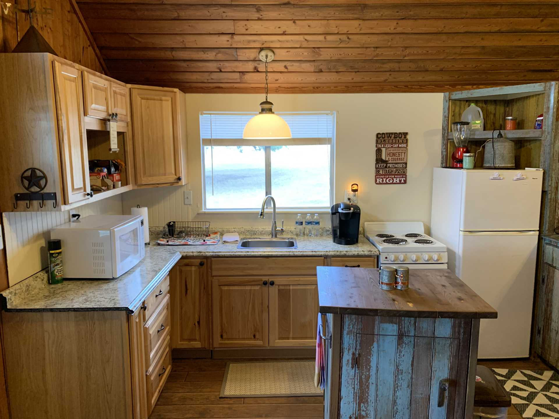 The handsomely-detailed Pony Cabin kitchen includes plenty of counter space and a food prep island.