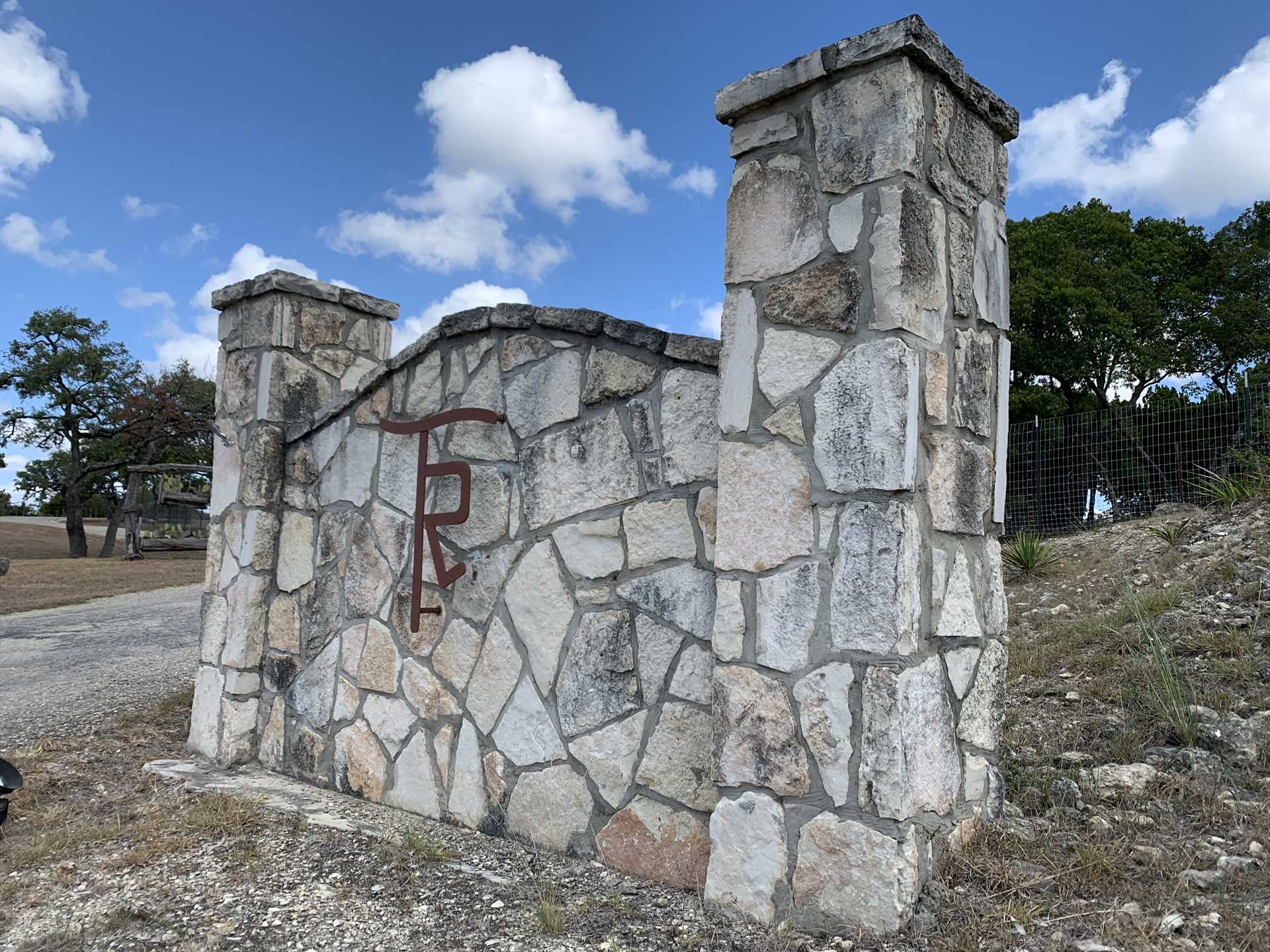 This stone gate on the road marks Tabasco Ranch, and serves as your gateway to a wonderful Hill Country holiday!