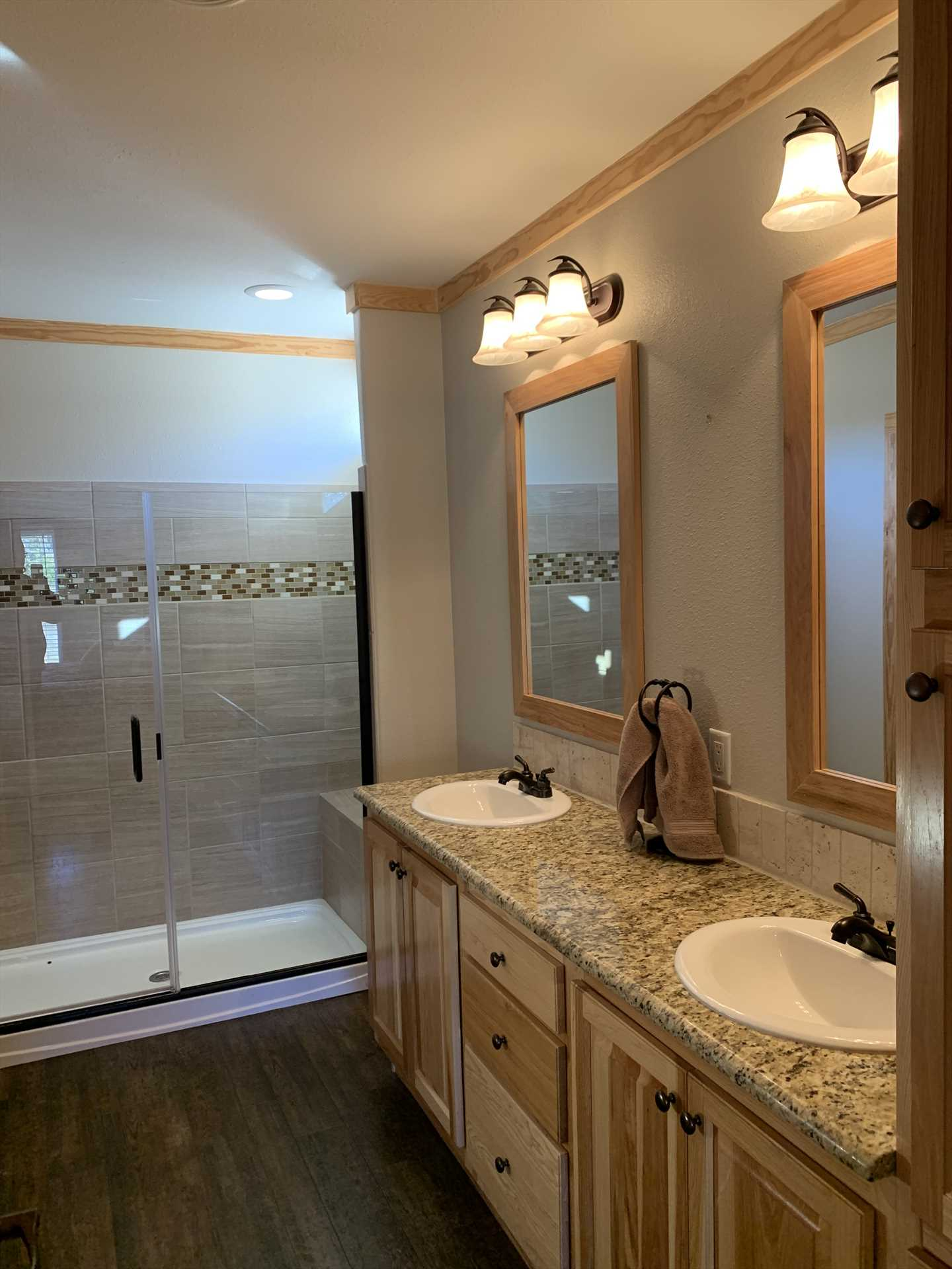 The sharp and stylish master bath includes a roomy walk-in shower and twin vanities. Both full baths at the Hideaway include clean towels and linens.