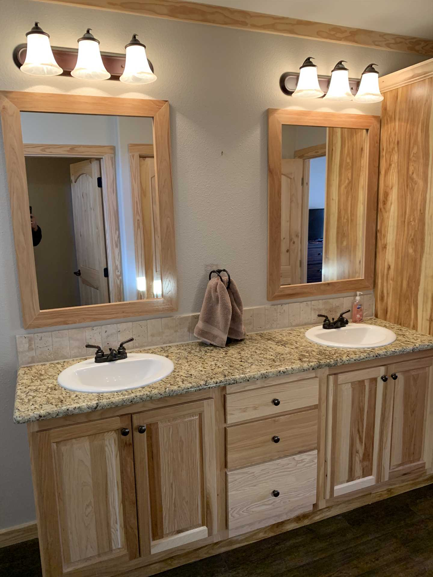 Plenty of counter space between the master bath's twin vanities mean you won't have to live out of a suitcase!