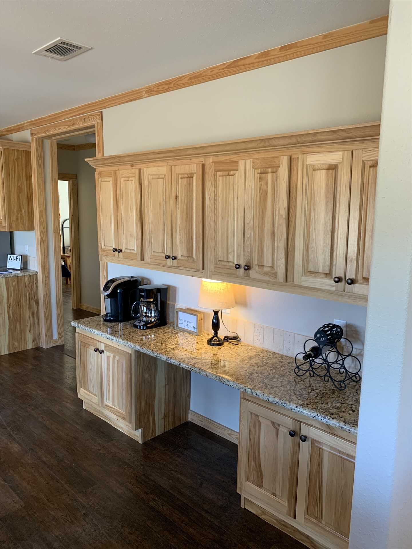 The fully-stocked kitchen (with two types of coffee makers!) includes a cozy dining nook.