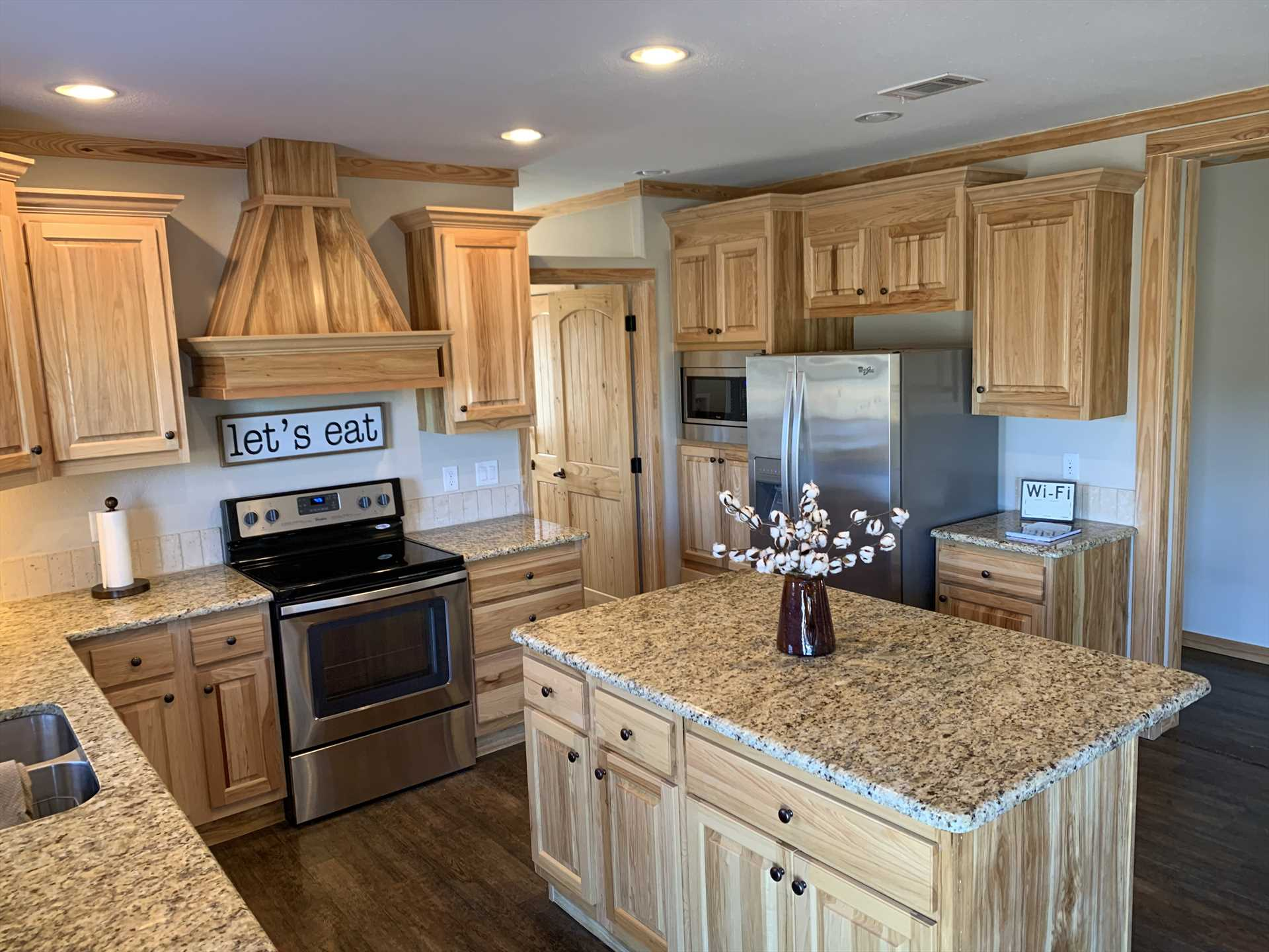 Tons of preparation space, modern appliances, and all the cookware and serving ware you'd ever need, make the big, beautiful kitchen a foodie's dream!.