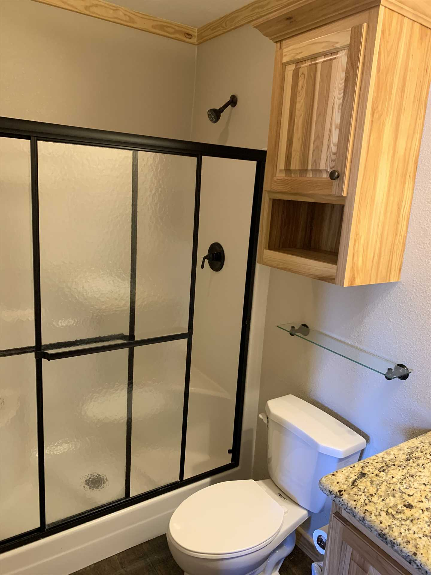 A stylish and functional shower stall in the second bathroom makes cleanup a relaxing pleasure!