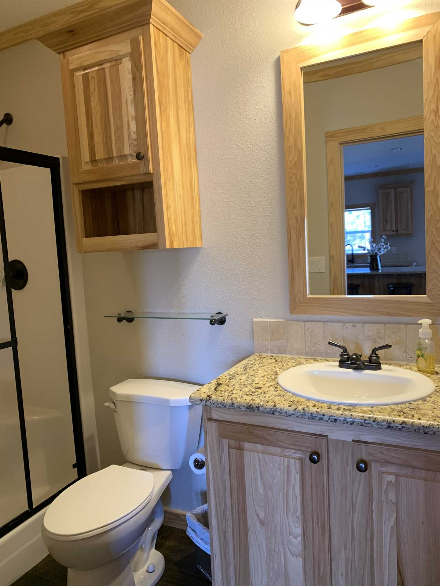 Both bathrooms here are immaculately clean, and the second bath (pictured here) includes a nice mirrored vanity and fresh linens.