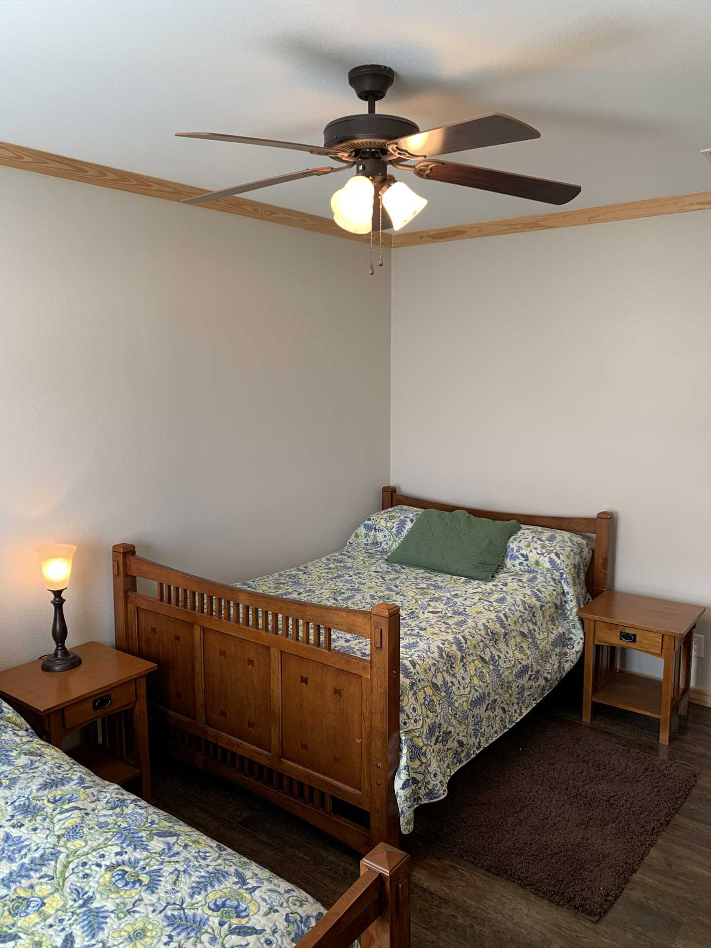 The second bedroom has two double beds that are not only matched, but feature matching furnishings, as well. It's a comfy and quiet place to catch your forty winks.