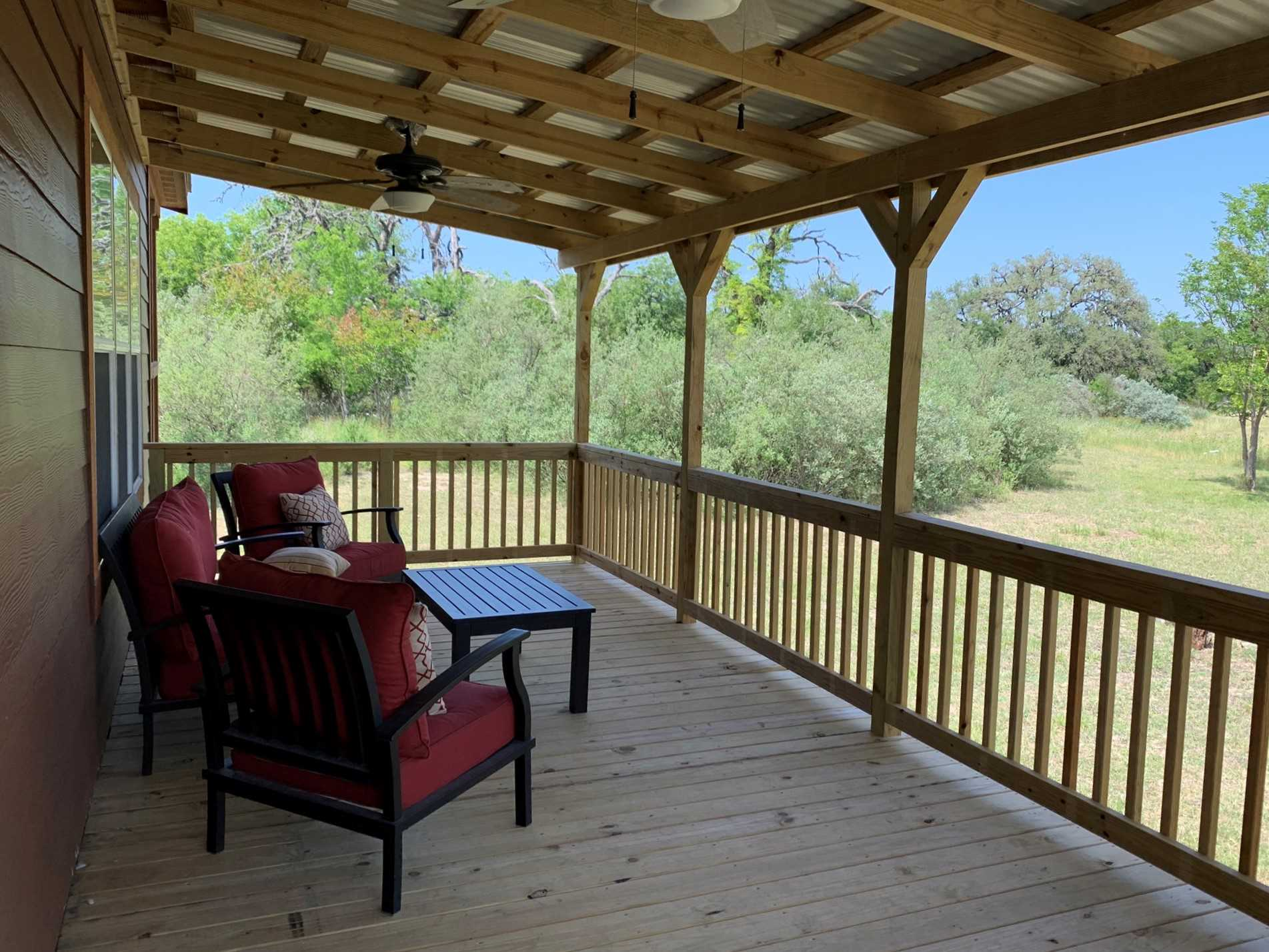 Ceiling fans on the porch will get a good breeze going when Mother Nature's in a calmer mood.