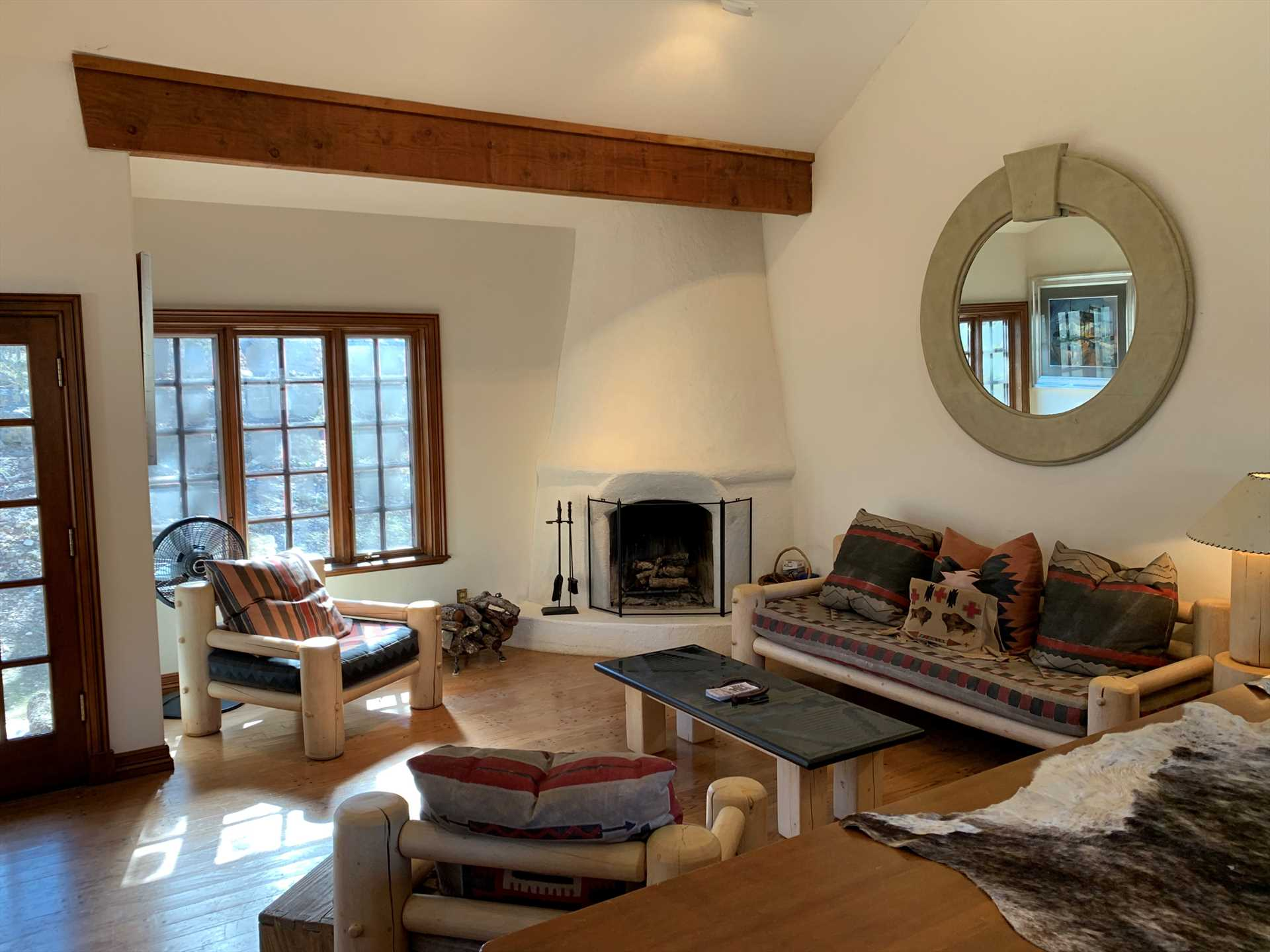 High ceilings, plenty of comfy furniture, and a warming fireplace make the living area a welcoming and roomy place for the family to gather.