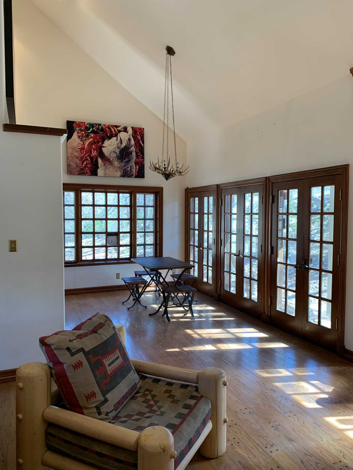 Warm sunlight pours into the dining and living areas at your Hill Country getaway, it's an incredible space for the whole family!