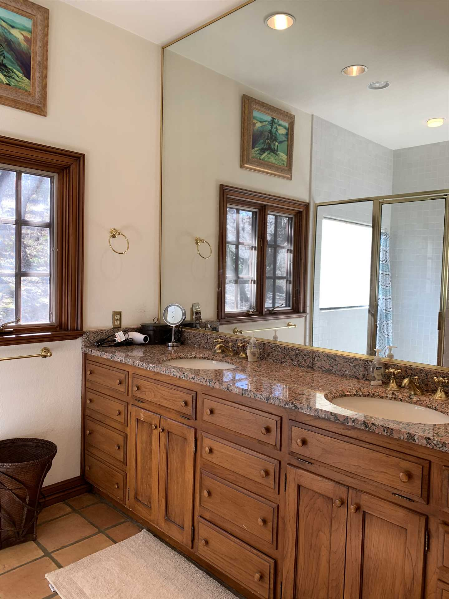 A giant, mirrored double vanity is in the second full bath, with plenty of counter space for your toiletries!