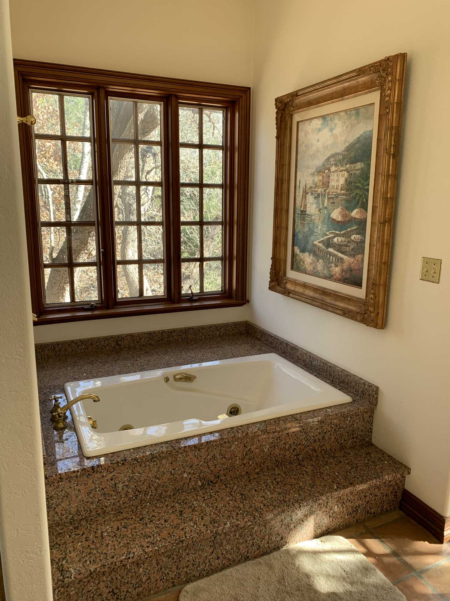 Sink in for a warm soak in the garden tub! This is a great little nook for some relaxing me-time.