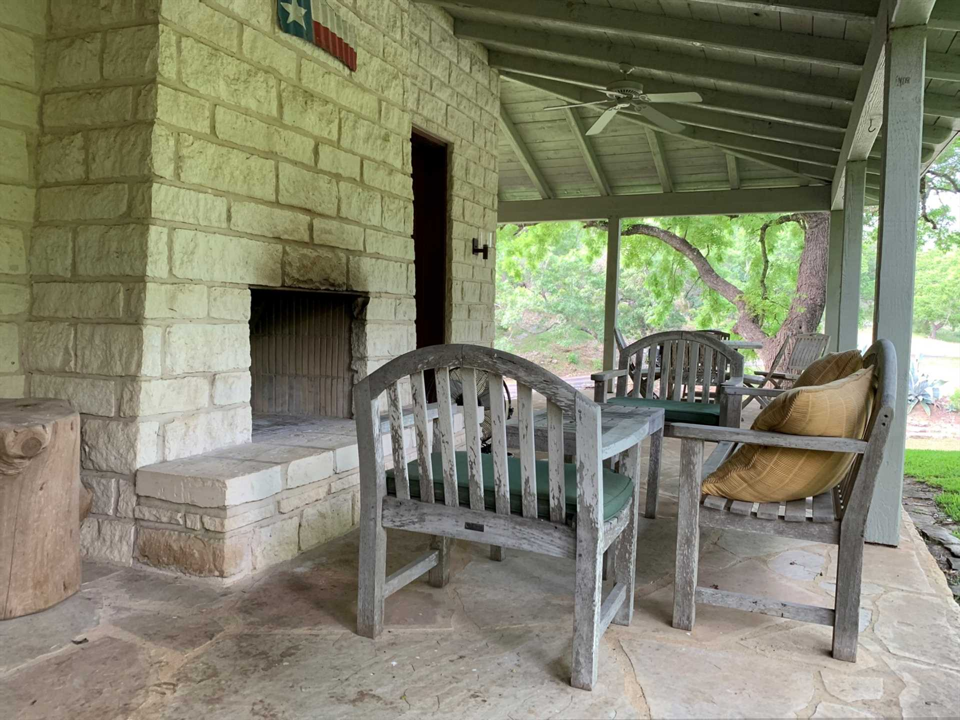 An outdoor fireplace and ample seating on the patio set a wonderful stage where you can enjoy the great outdoors!