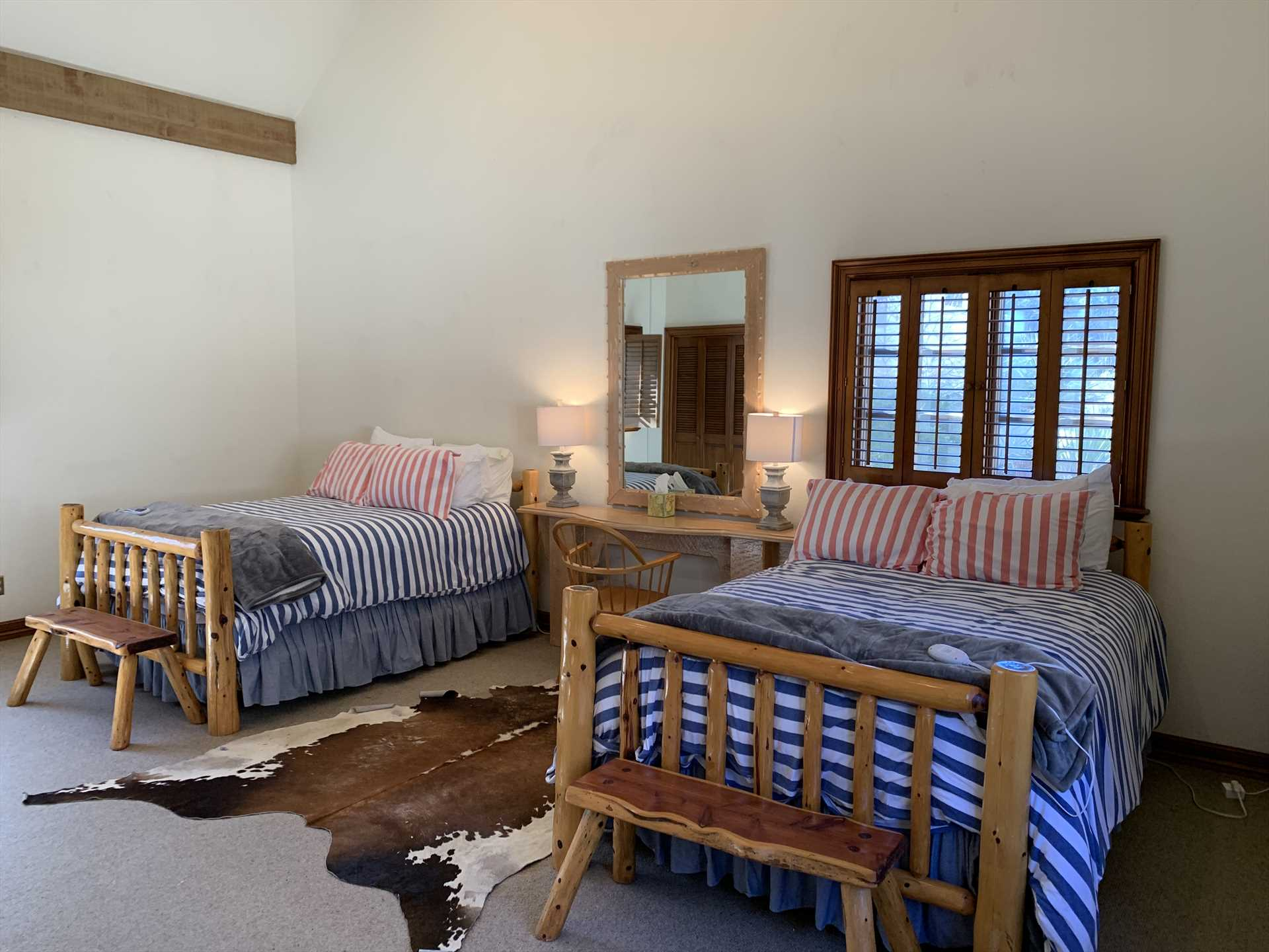 This is just one of the three bedrooms in the Homestead-and you have an option for two comfortable trundle beds here, too.