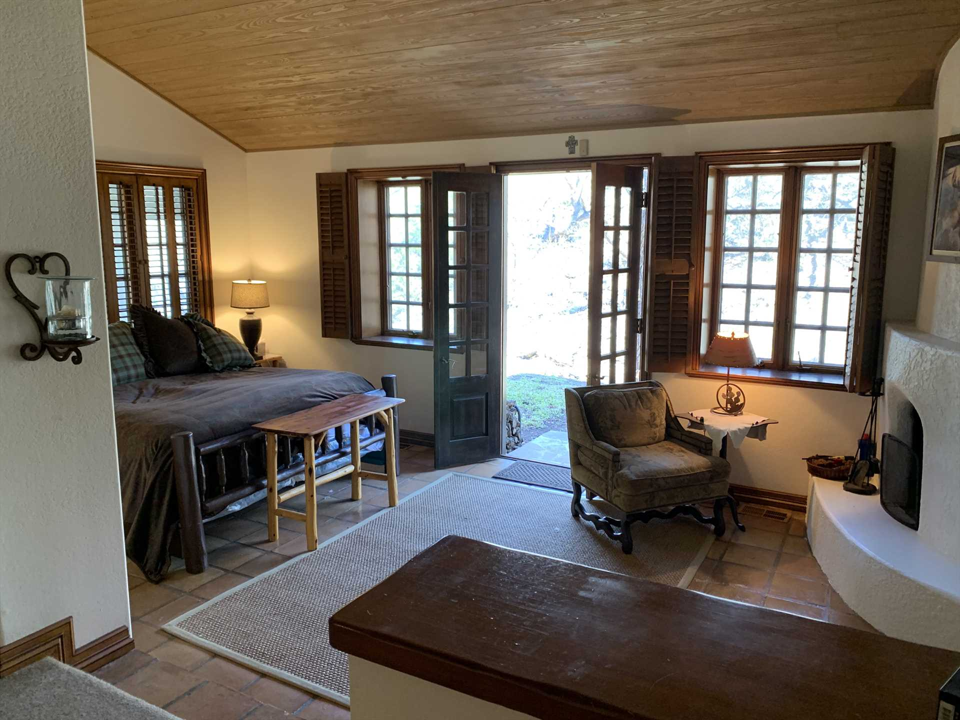 The huge master suite in the Homestead includes a king and queen bed-and all bed and bath linens in all the guest homes are provided. Those big double doors open directly to the great outdoors, too!