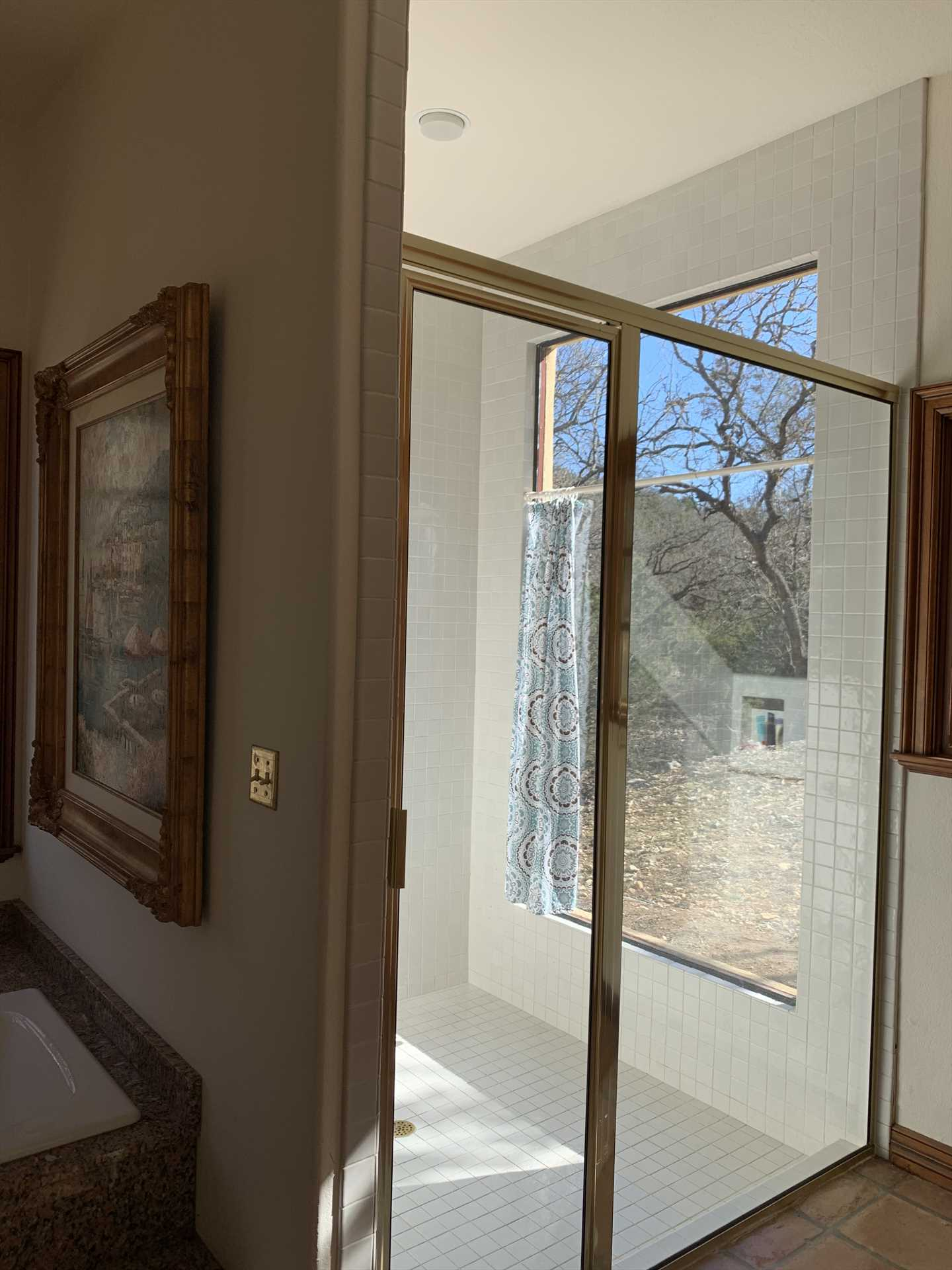 The big glass-walled shower in the Homestead's master suite is a spotless and roomy place to get clean-and it's located where you'll have privacy, too.