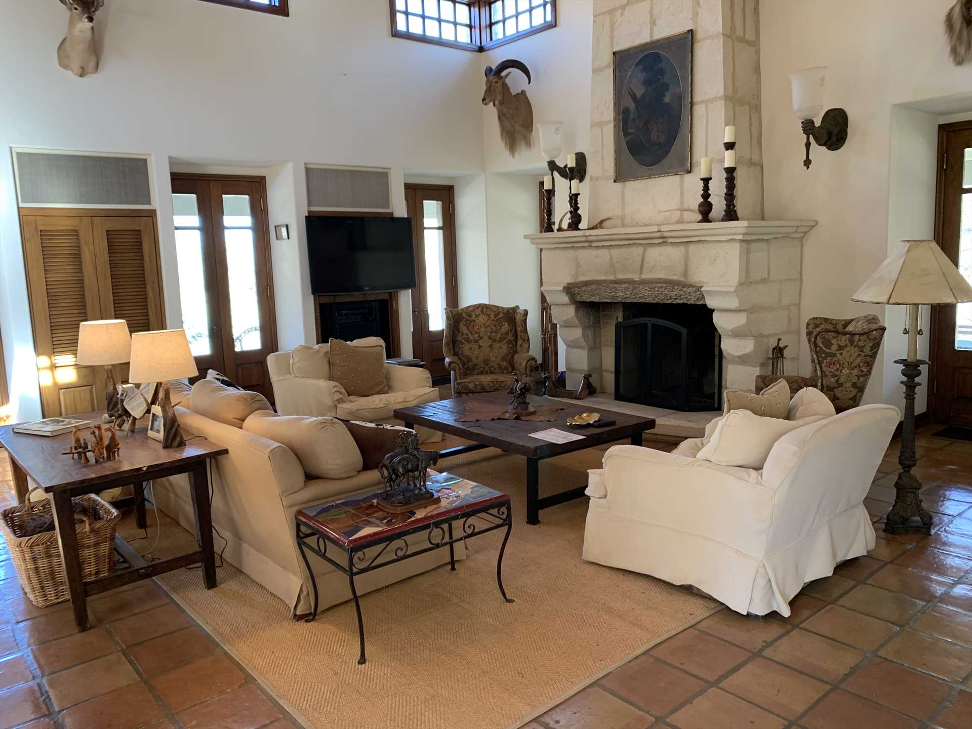 With ultra-high ceilings, comfy furniture, and a huge stone fireplace, the Homestead conveys a country castle vibe.
