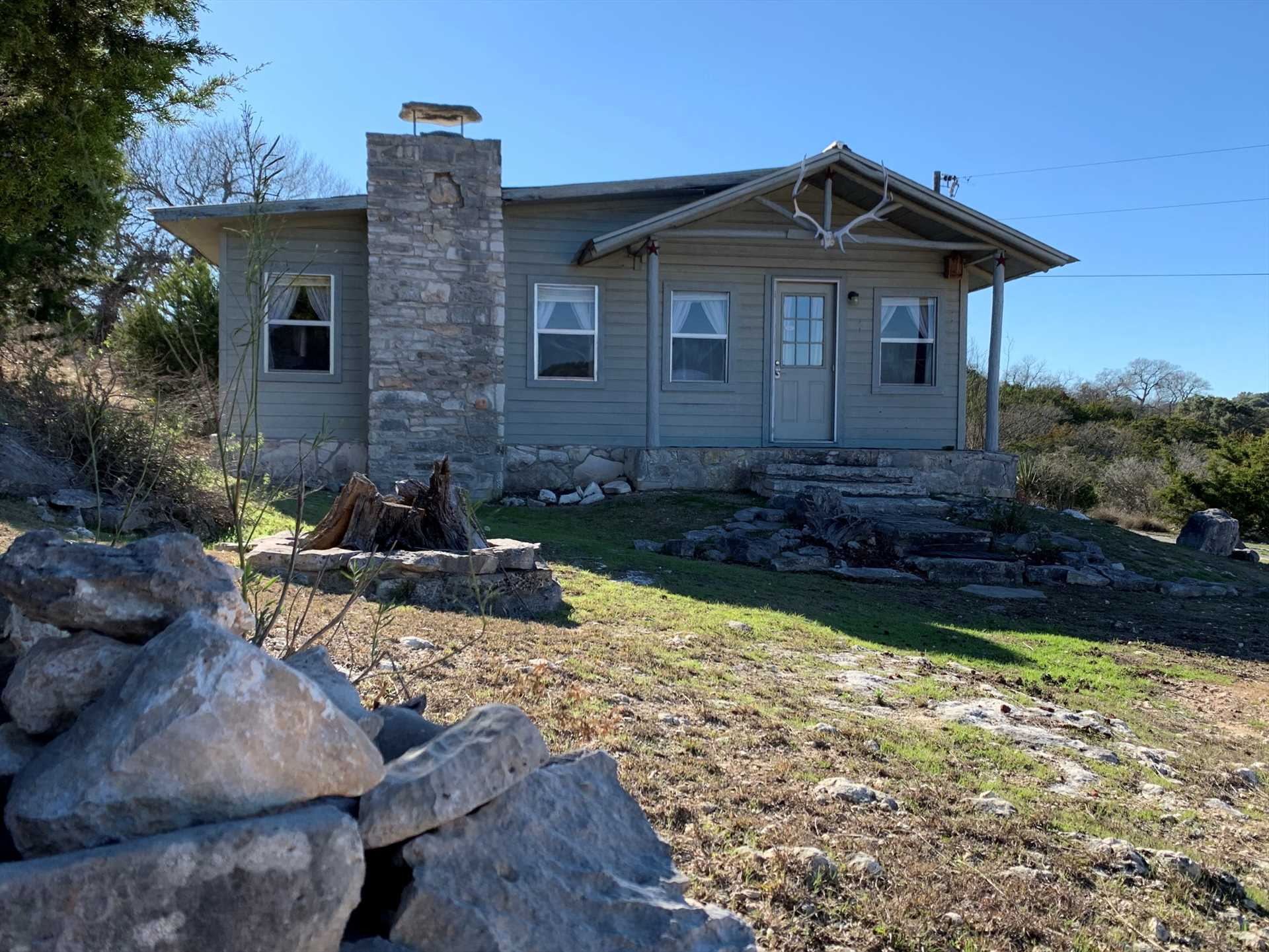Overlooking the grandeur of the Hill Country is the aptly-named Hill House!