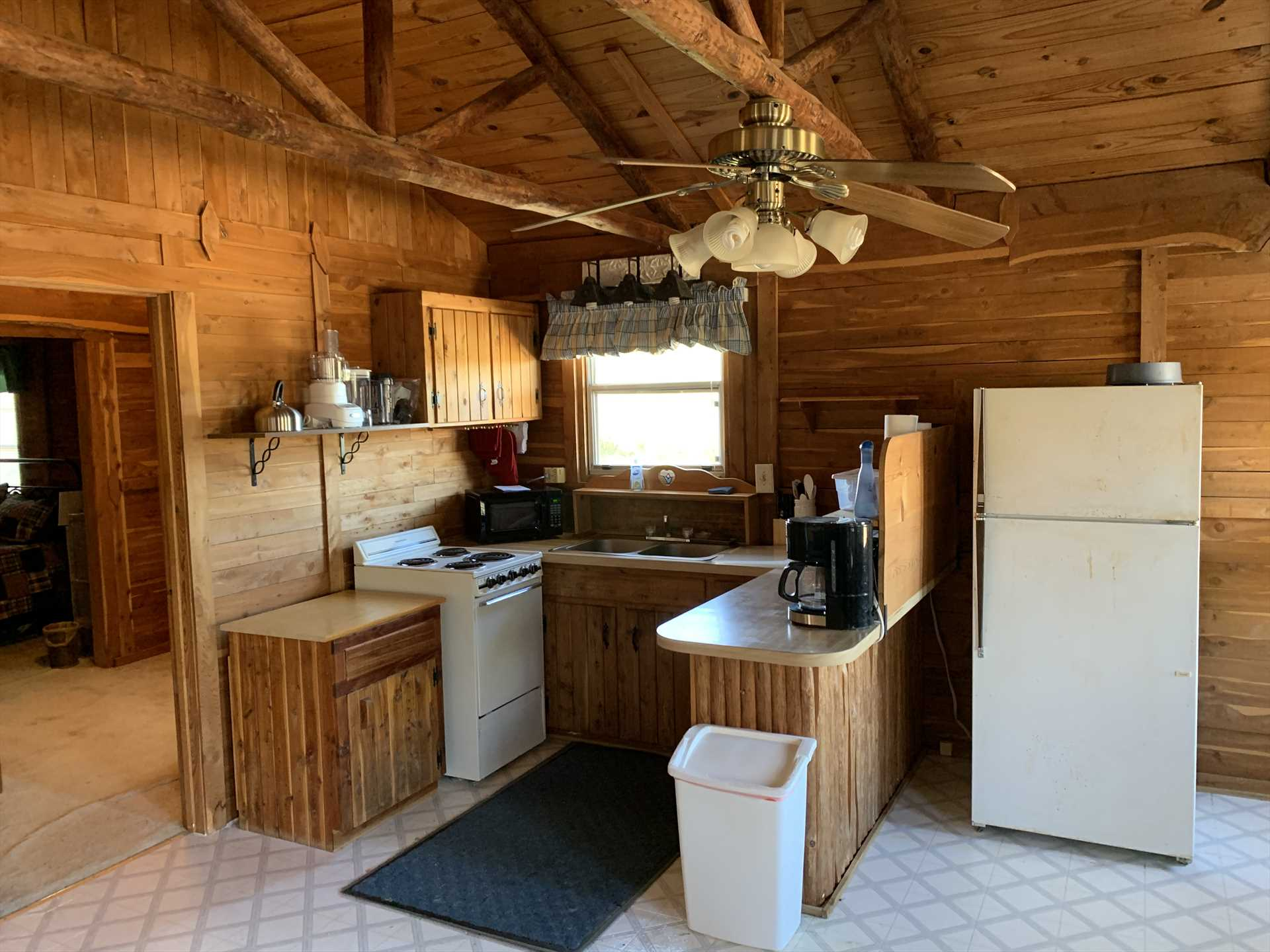 A stove, fridge, microwave, and coffee maker are all in the Hill House's kitchen-as well as a wood-burning grill outside!