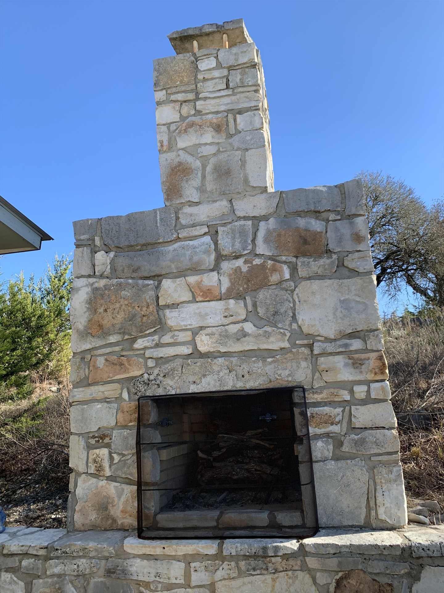 The MASSIVE outdoor fireplace offers a fun gathering spot, and plenty of room for roasted marshmallows and s'mores for everyone!