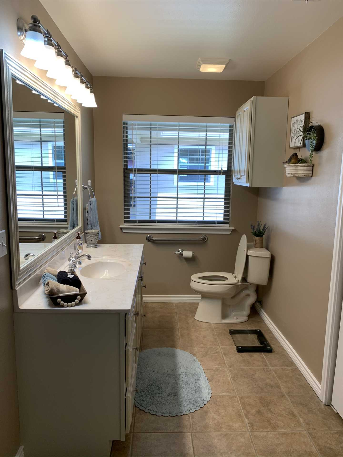 In the roomy master bath, you'll find an enormous mirrored vanity, and a special feature, as well....