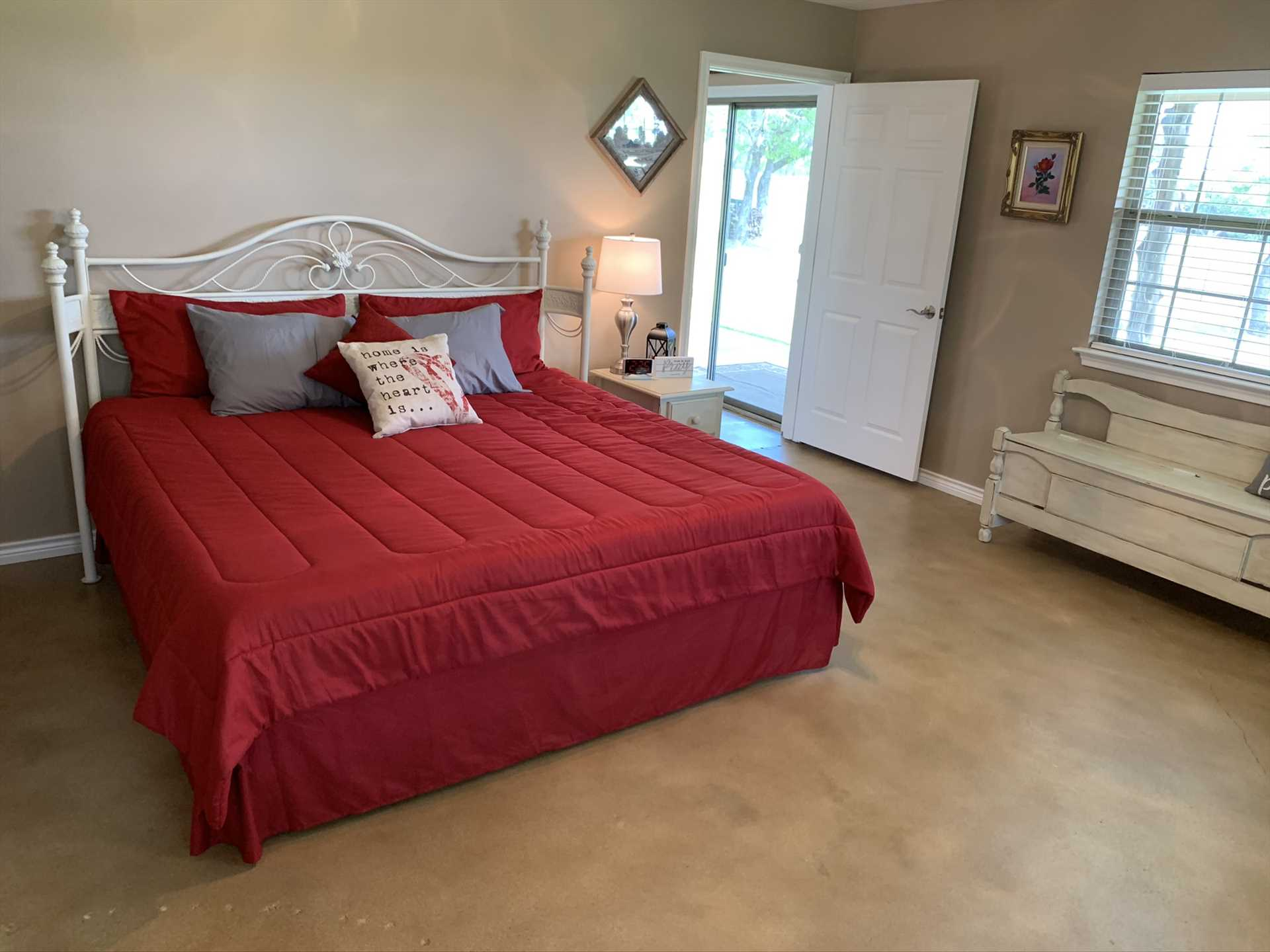The highlight of the third bedroom here is a plush king-sized bed, draped with clean and warm linens-as are all the beds here!