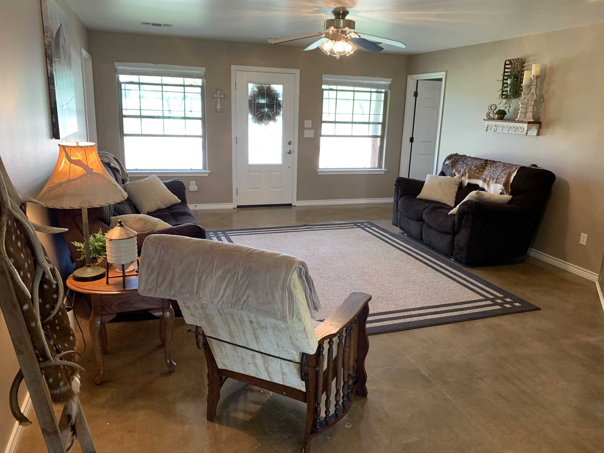 Multiple recliners, a gas fireplace, a TV with DVD player and Roku, board games, and Wifi assures the huge living space has something for everyone!