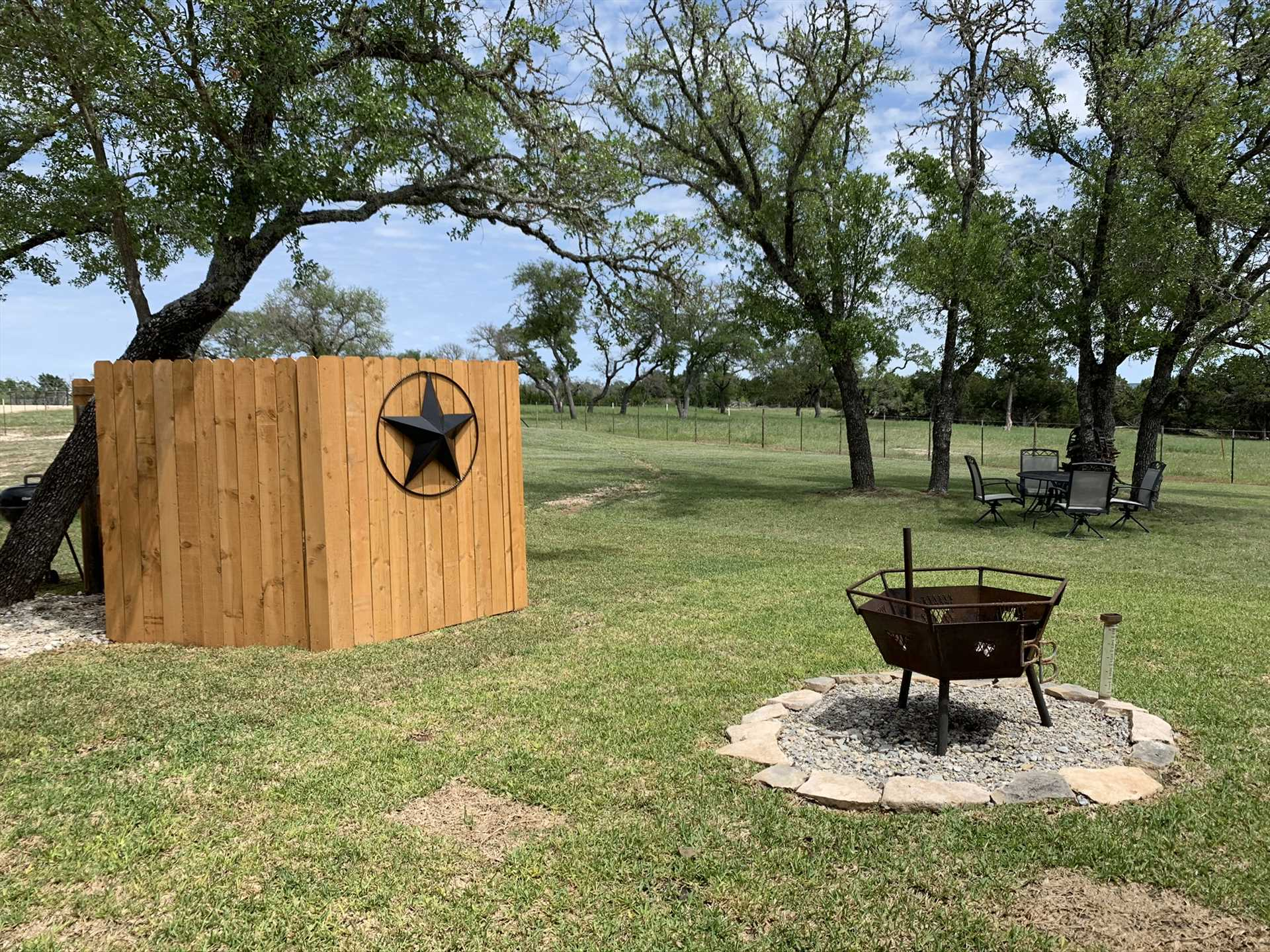 A fire pit and charcoal grill out back make it easy to cook up something special outside! There are also corn hole bags and boards, and a telescope for checking out the Milky Way.