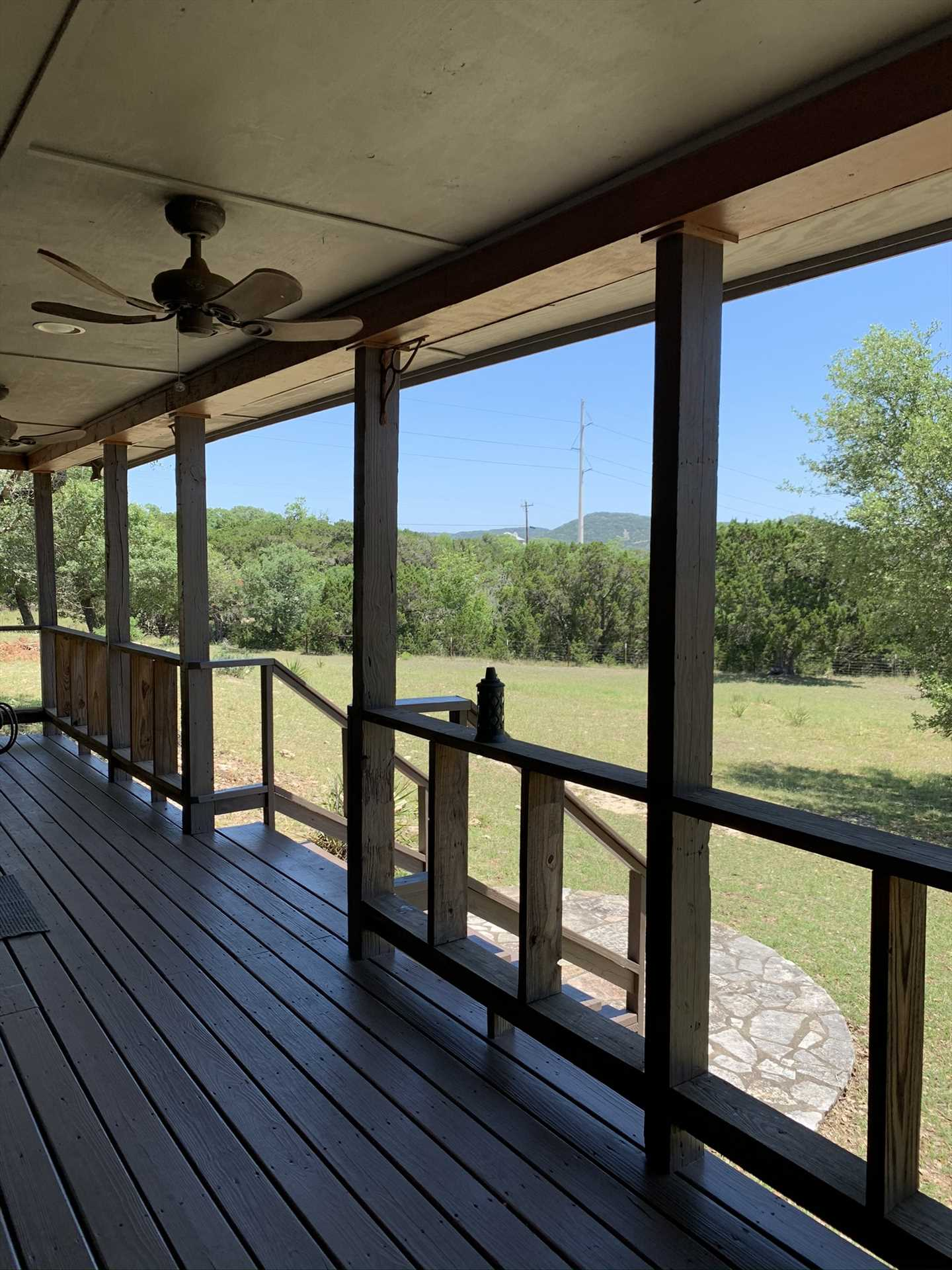 Even on still days, you can stir up a Hill Country breeze on the shaded porch with the help of ceiling fans.