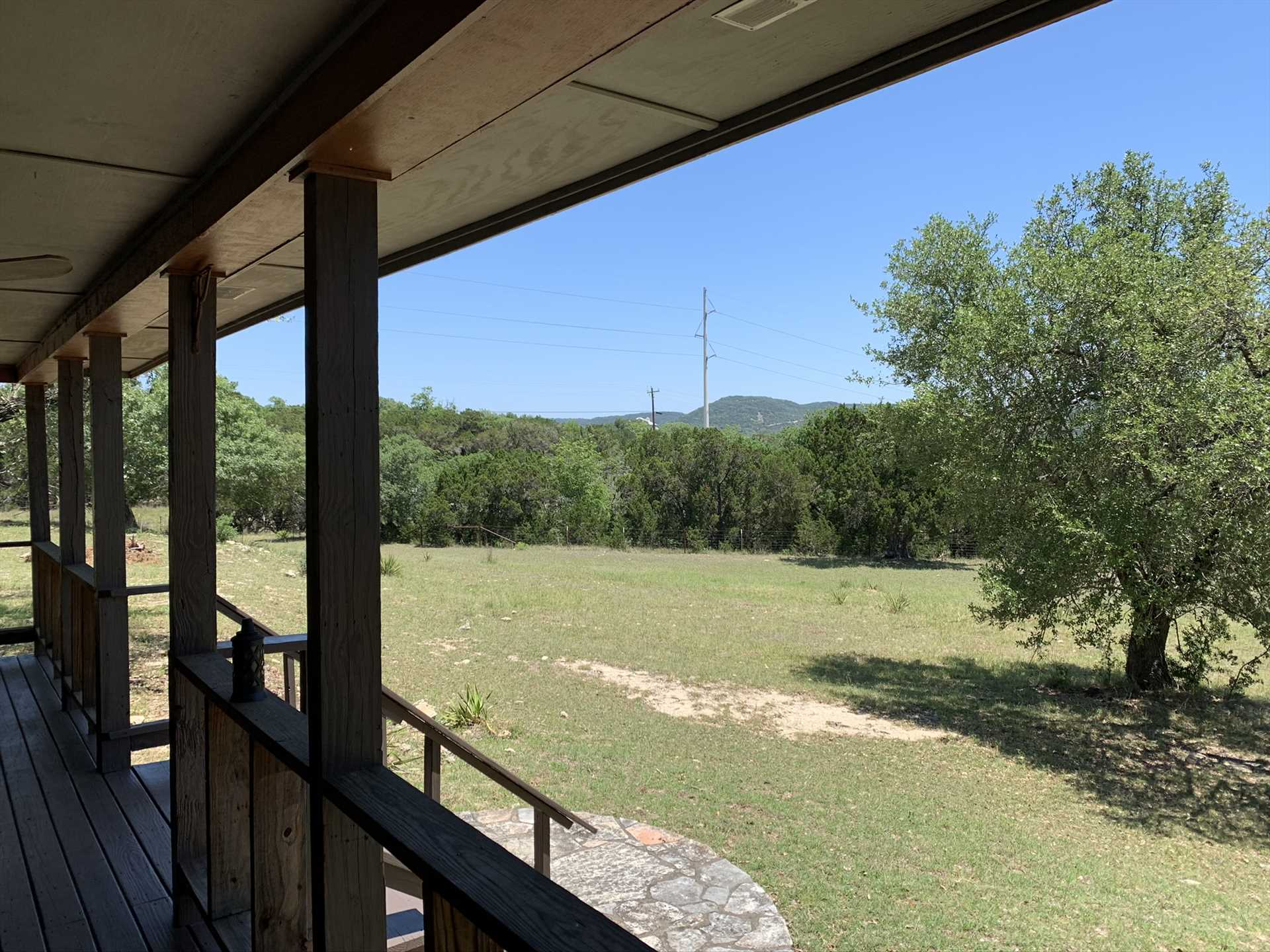 No matter the time of year, or the time of day, the view from the shaded porch shows off the very best of the Texas Hill Country.