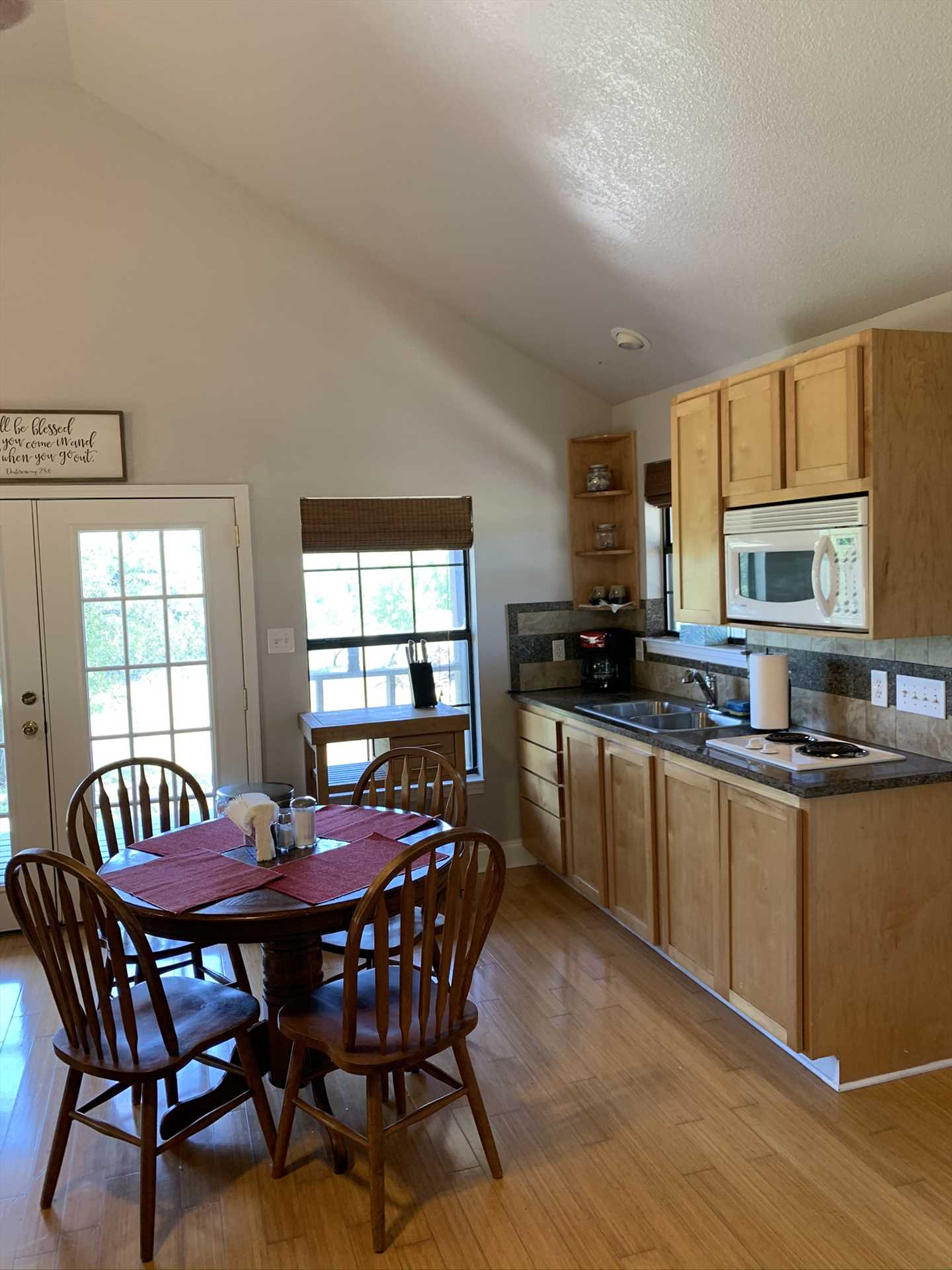 Blond wood furnishings and matching flooring create a comfortable and friendly space in the kitchen and dining room.